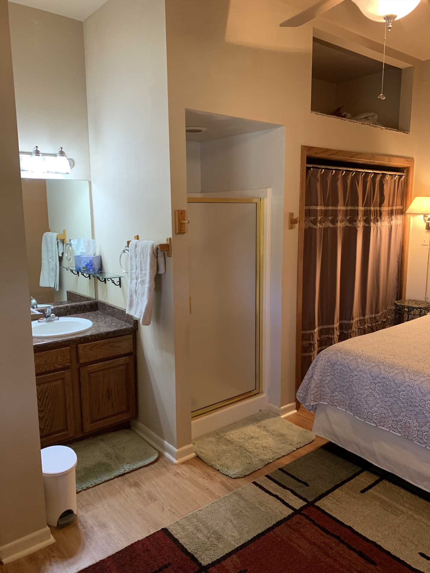 Cleanup's a breeze in the shower and mirrored vanity-and all bed and bath linens are provided for your stay.