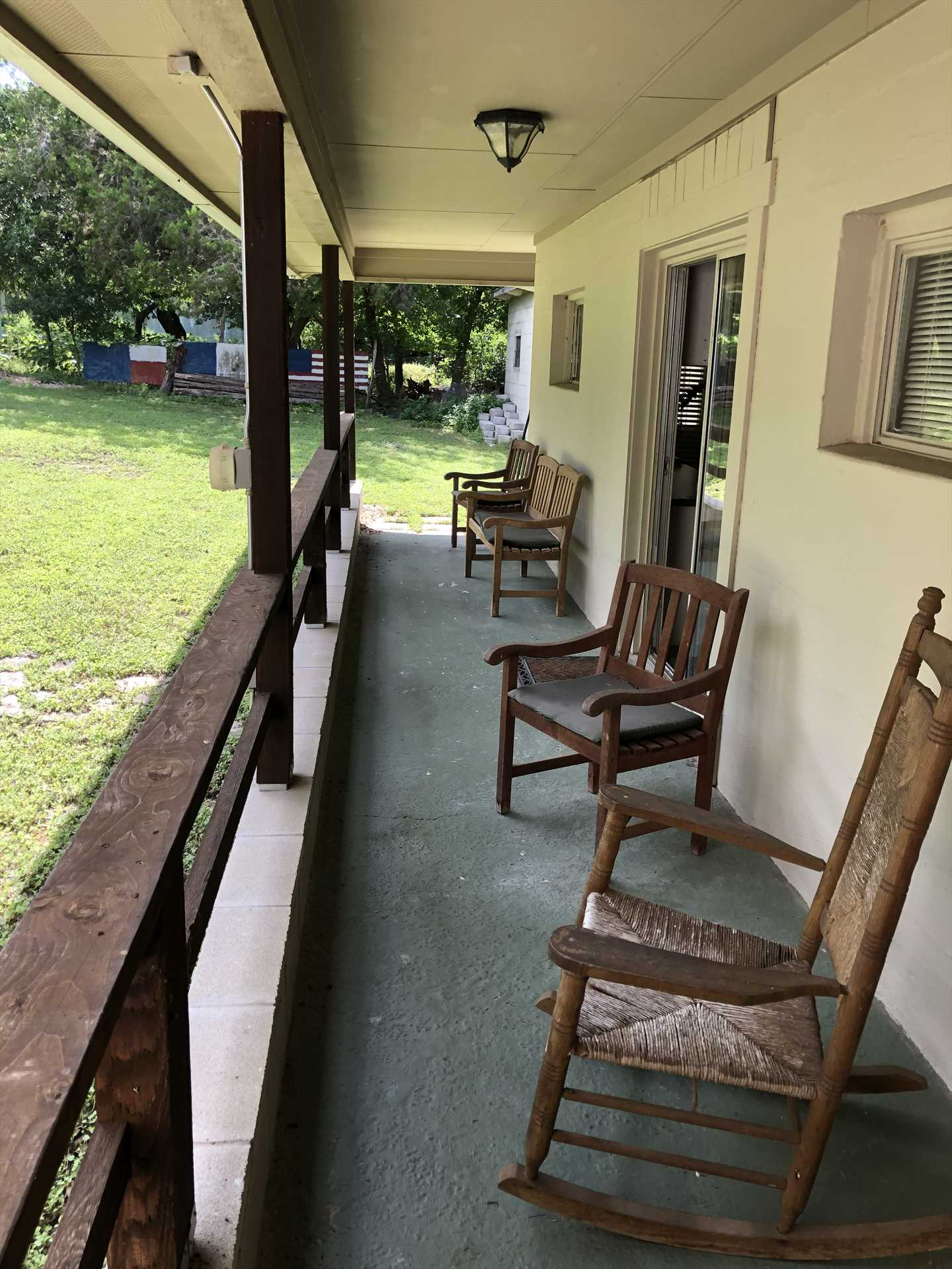 Kick up your feet in relaxing country comfort on the shaded front porch!