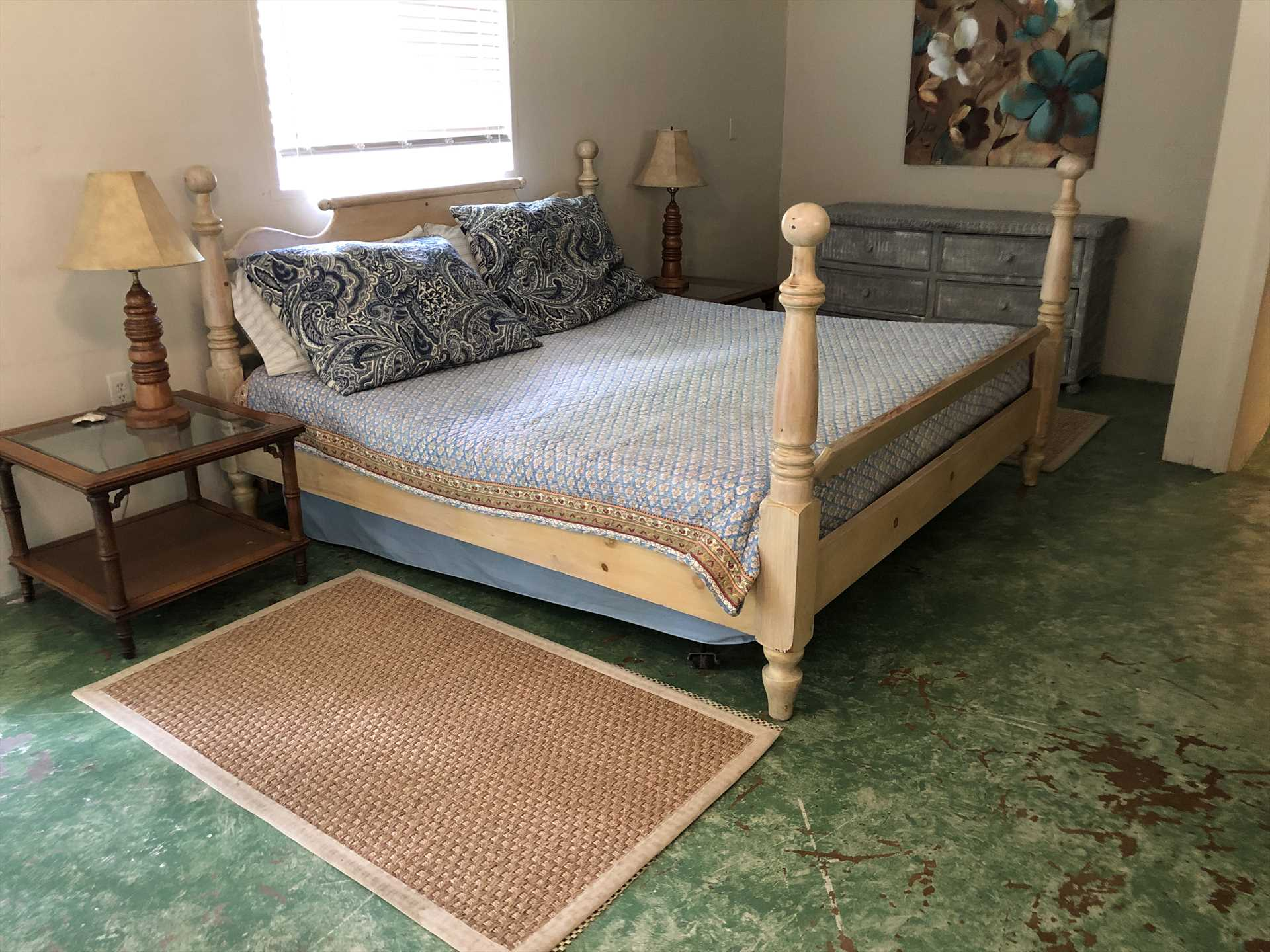 The master bedroom includes not only a great big king-sized bed, but a couch and intimate dining area, as well. It also has its own bathroom!