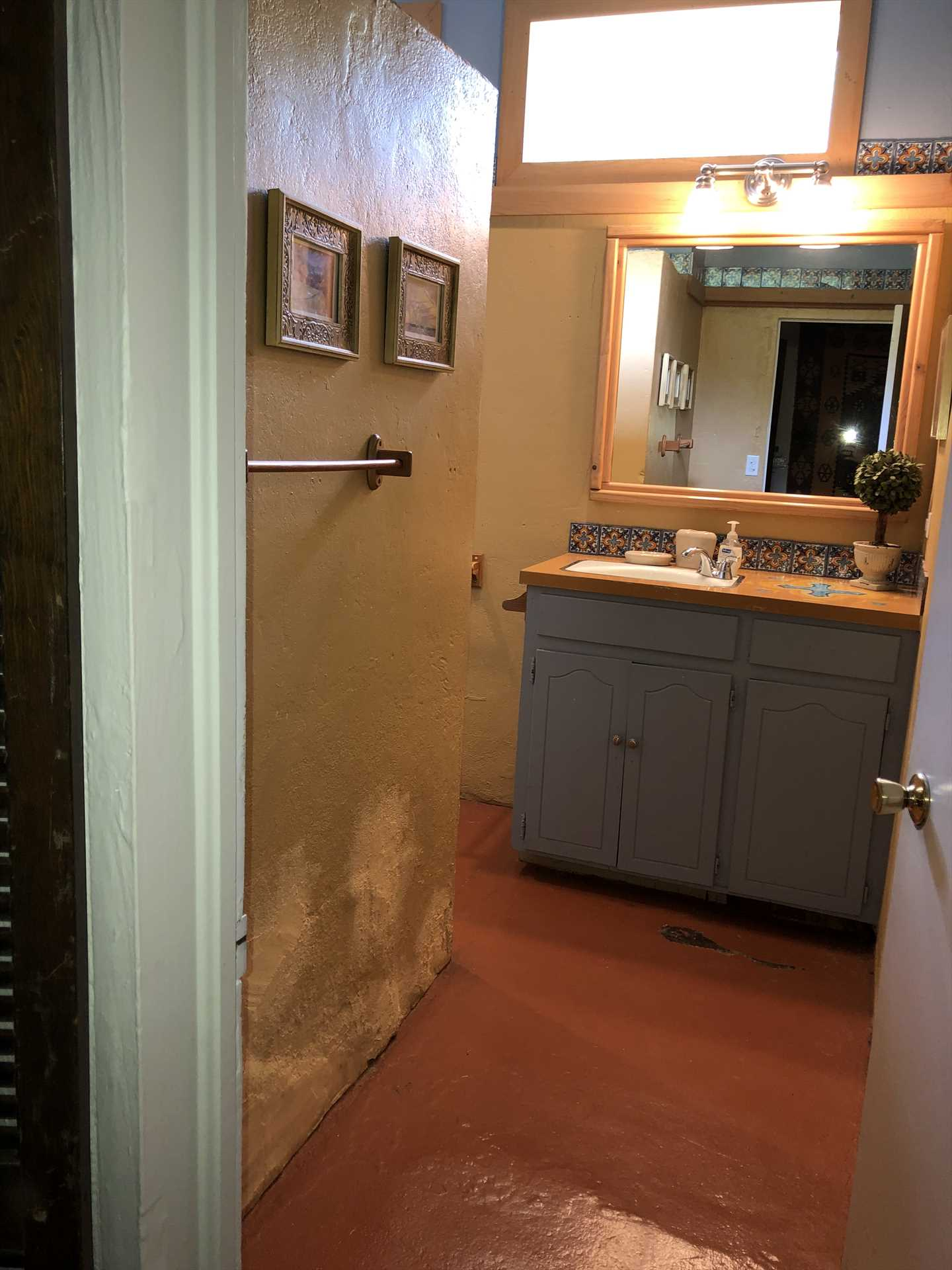 This full bath (one of three) features a shower stall and a warm color scheme. Bed and bath linens are provided for everyone!
