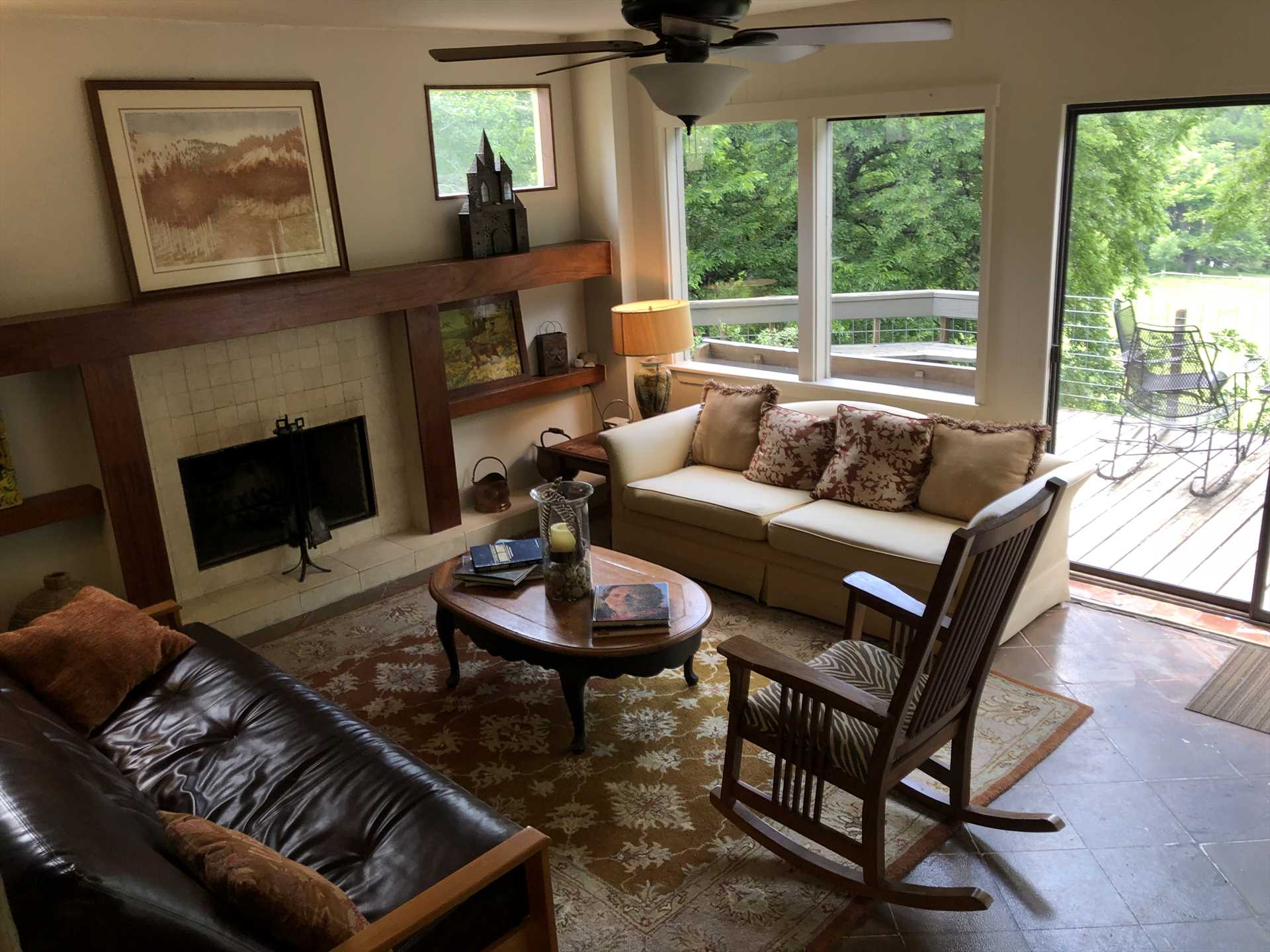 The second living area opens out onto the spacious deck, and the big windows and doors invite in plenty of natural light and inspiring views!!
