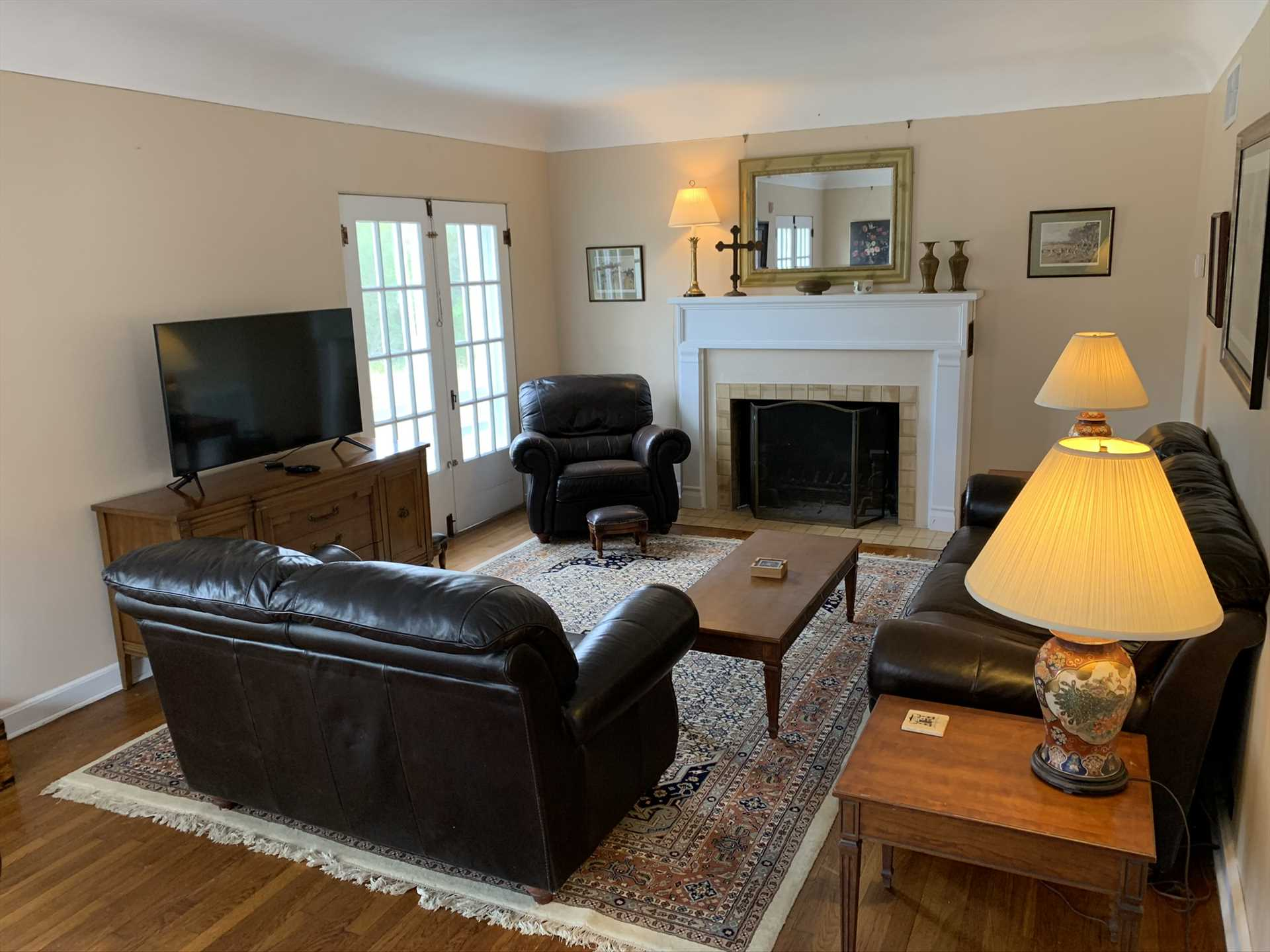The comfortable living room features plush furniture, TV with Roku, and there's Wifi Internet service and central air and heating throughout the house.