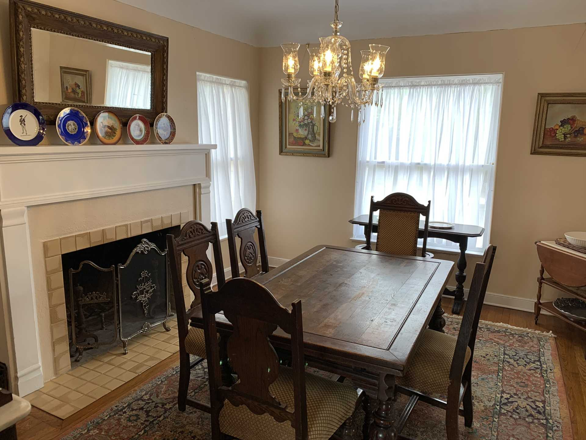 Antique woodwork highlights the dining room, which offers a historic and homey setting for your family feasts.