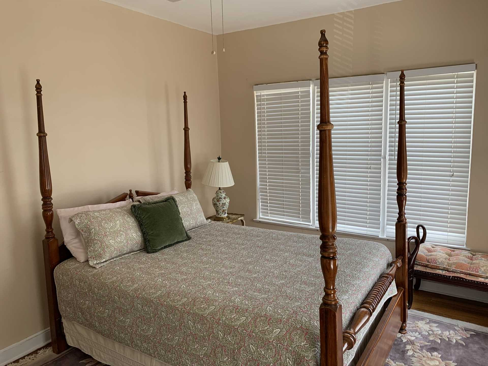A four-poster queen-sized bed in the master bedroom provides a little slice of history and a lot of restful slumber!