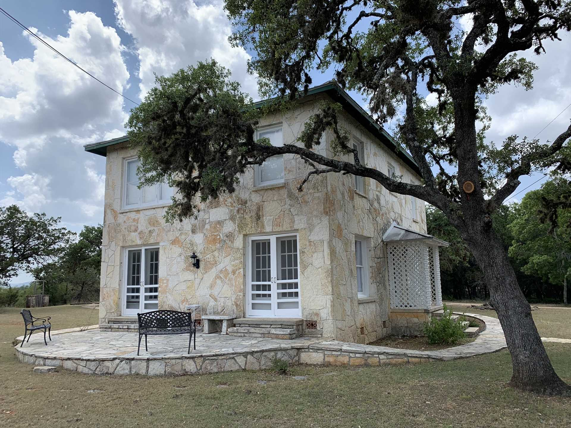 This riverside palace was built in the 1930s, and built to last! It's been modernized to provide a fun and memorable Hill Country getaway for your family and friends.