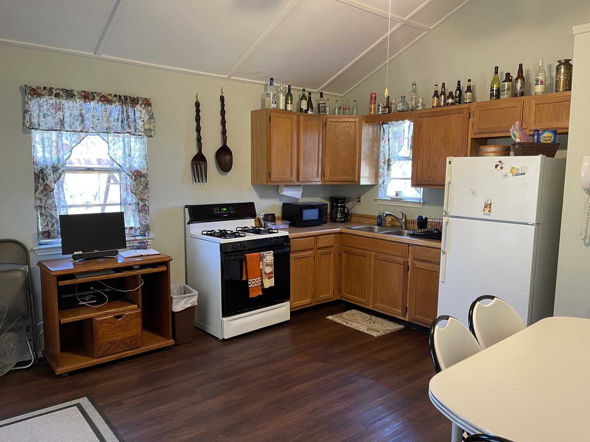 The full kitchen has a fun personality all its own! It's equipped with appliances and utensils, as well as a cozy dining area.
