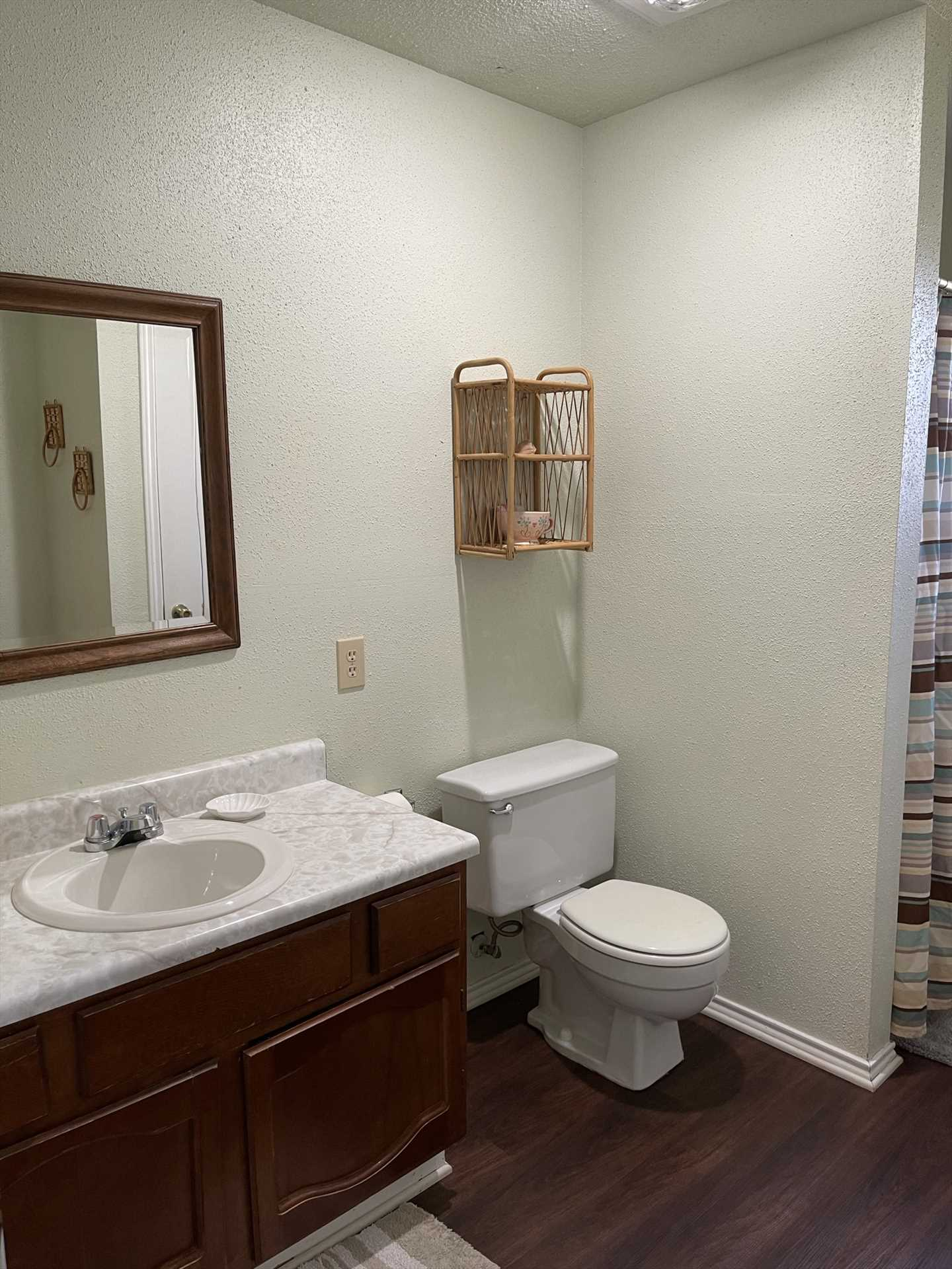 The full bath is sparking clean, and features a large vanity and shower for cleaning up! Bath linens are included, too.
