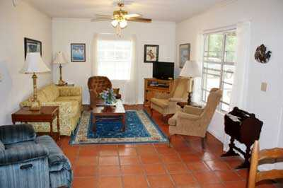 Satellite TV, AC and heating, and a queen sleeper round out the extras in the roomy and welcoming living area.