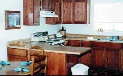 A full kitchen and dining area make family meals during your vacation a hassle-free and pleasant experience!