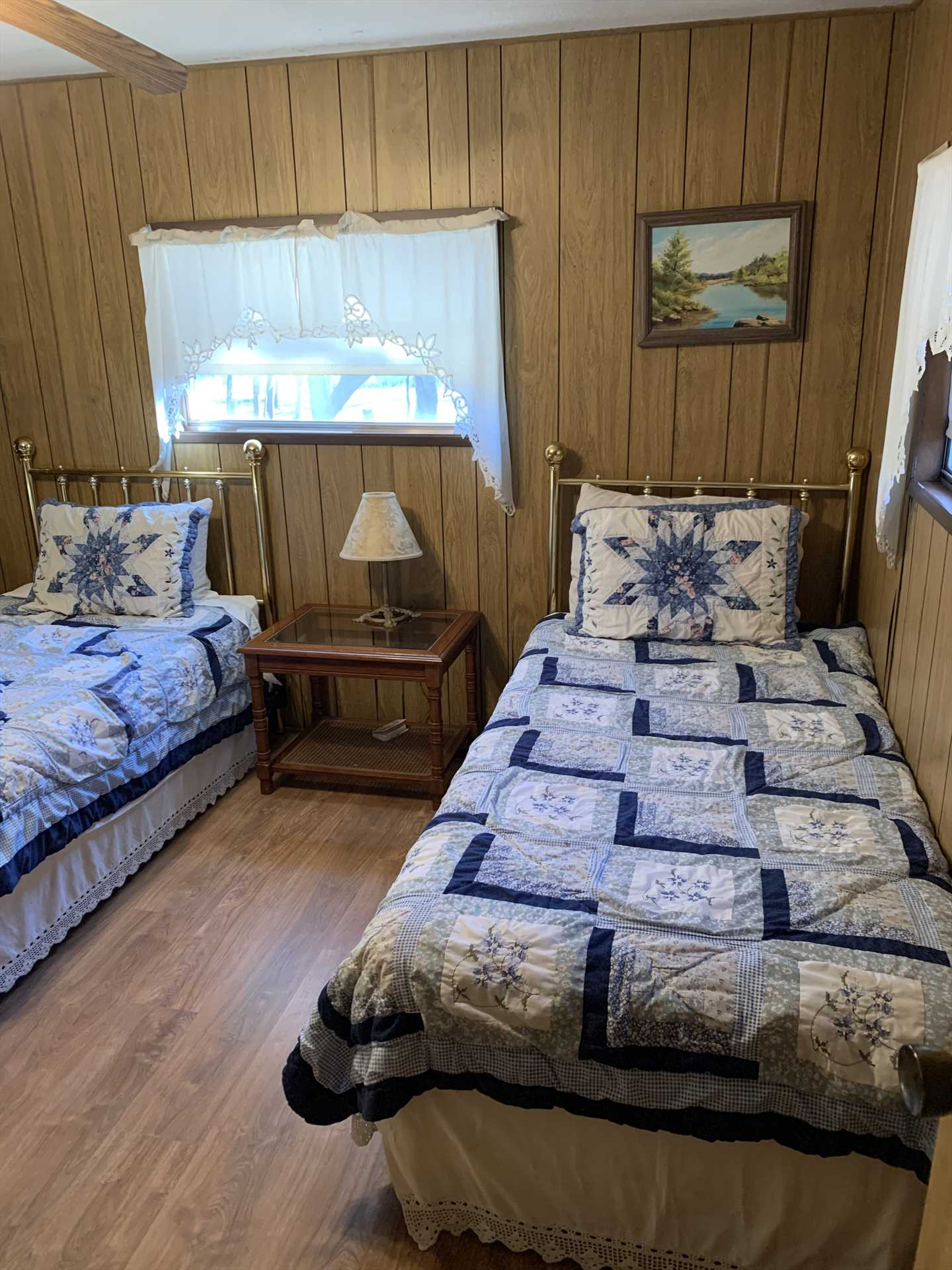 Two more guests can sleep in soft comfort in the second bedroom, equipped with matching twin beds.
