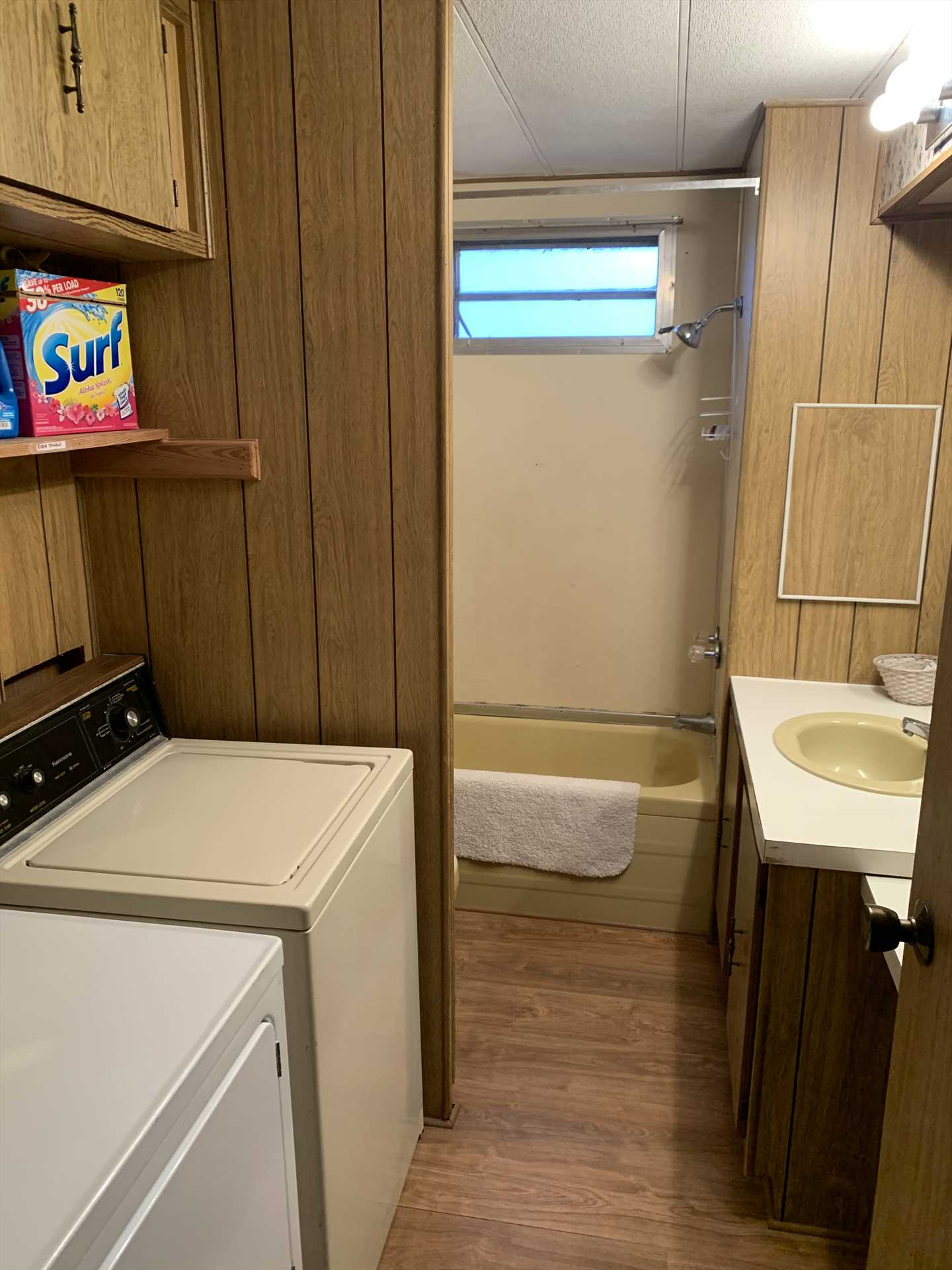 You'll find a shower/tub combo in the bathroom, and a handy washer/dryer combo close by, too!