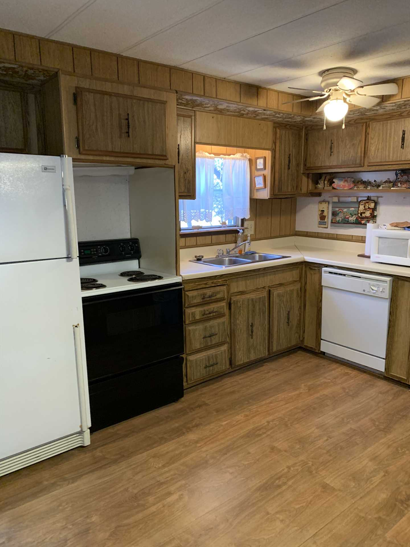 The roomy and spotlessly-clean kitchen has everything and everything for the culinary master in your group!