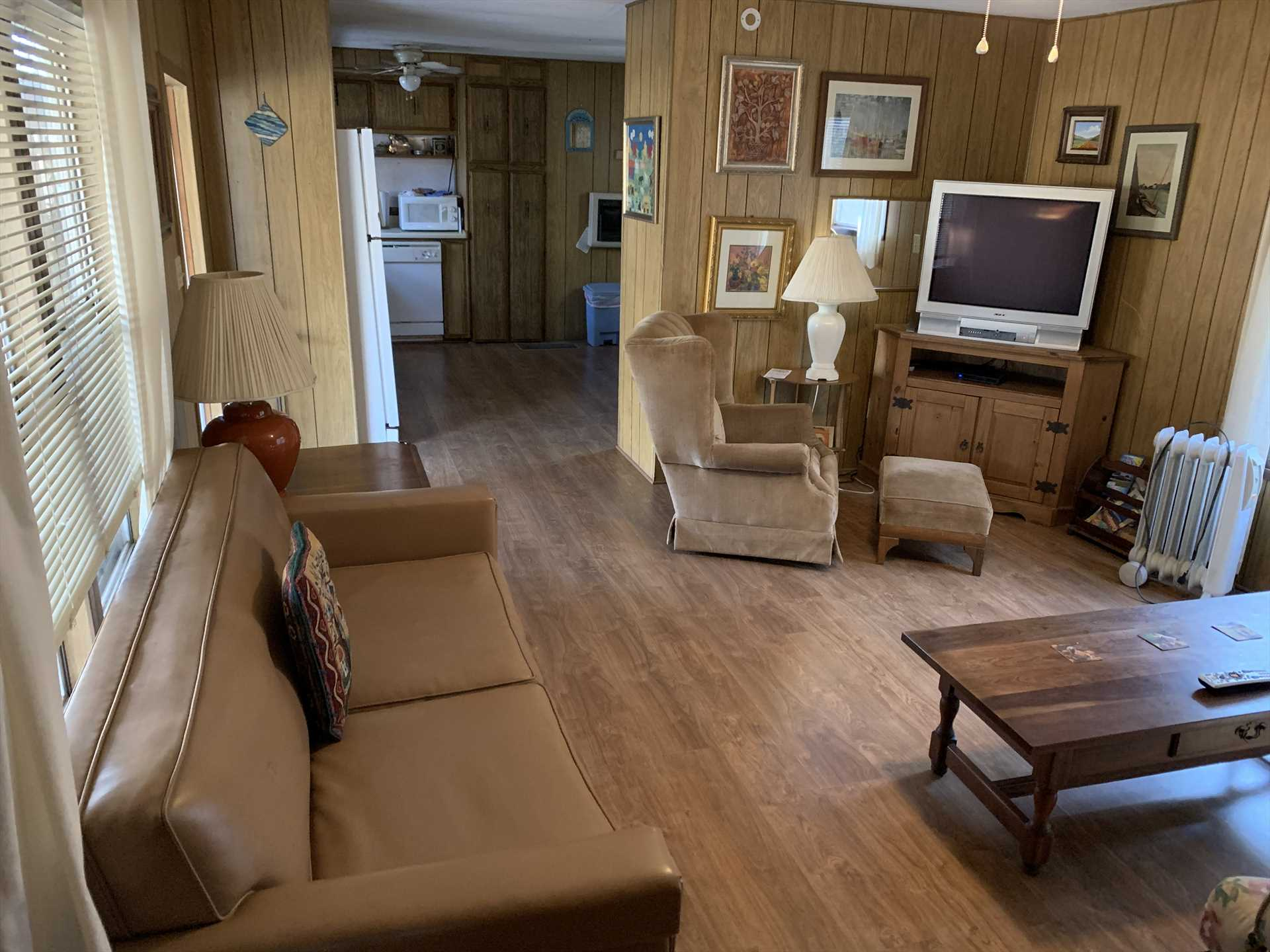 Woodwork and matching furnishings in Mobile 1 combine with natural light to create a welcoming atmosphere for our visitors.