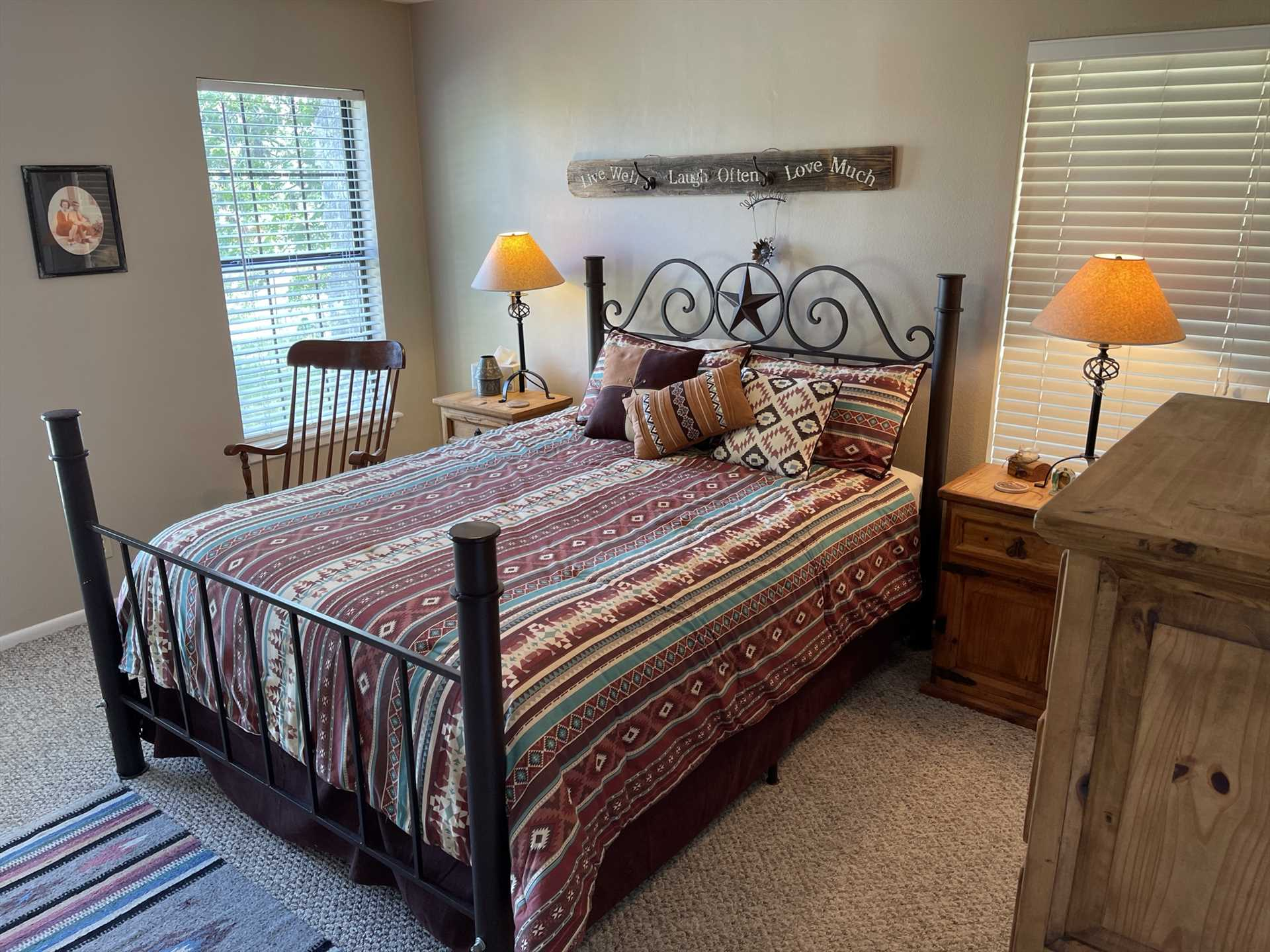 Natural light fills the master bedroom, which features a truly Texan place to sleep: a soft double bed with a Lone Star headboard!