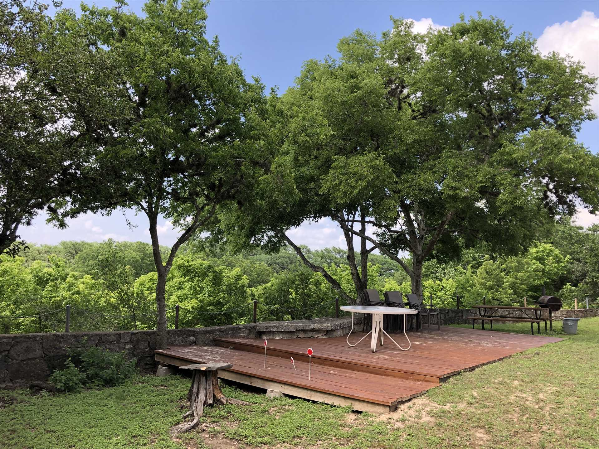 This shady patio offers a bird's-eye view of the Hill Country, its wildlife, and the expansive Texas skies.