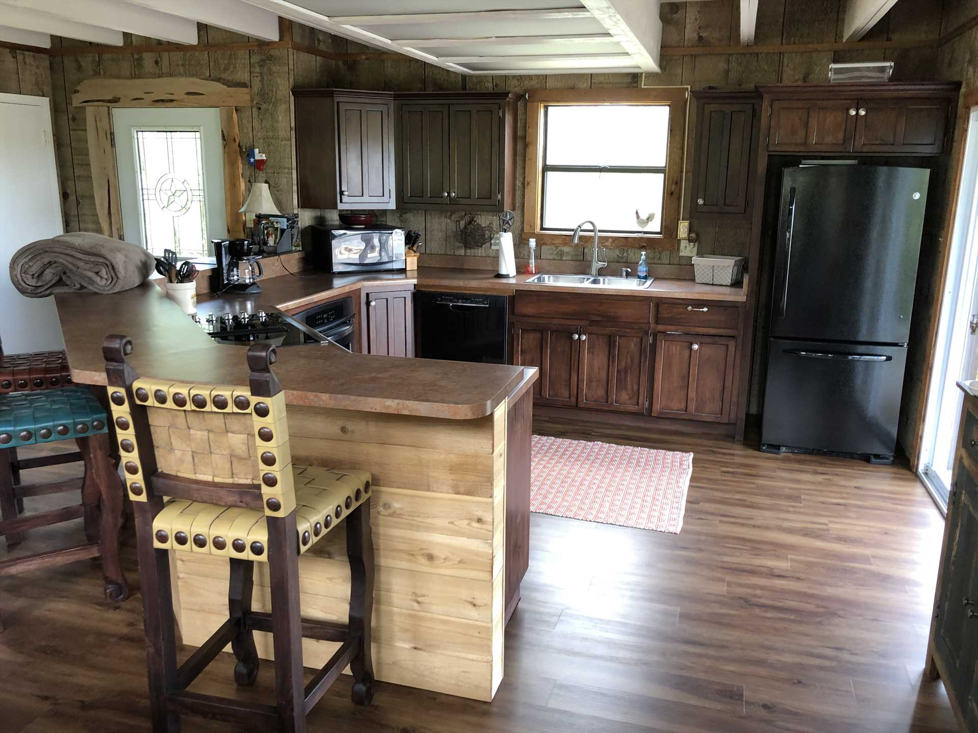 Modern appliances, plenty of counter space, and cooking and serving ware and utensils make the kitchen a delight for cooks and foodies alike!
