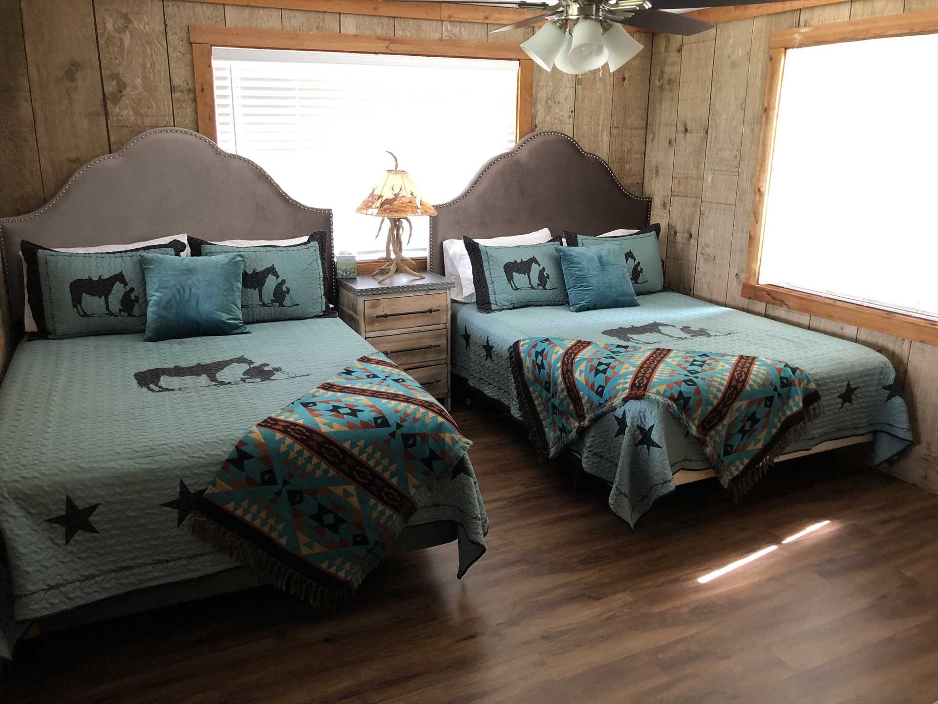 Doze like royalty in the two roomy queen beds in the second bedroom!