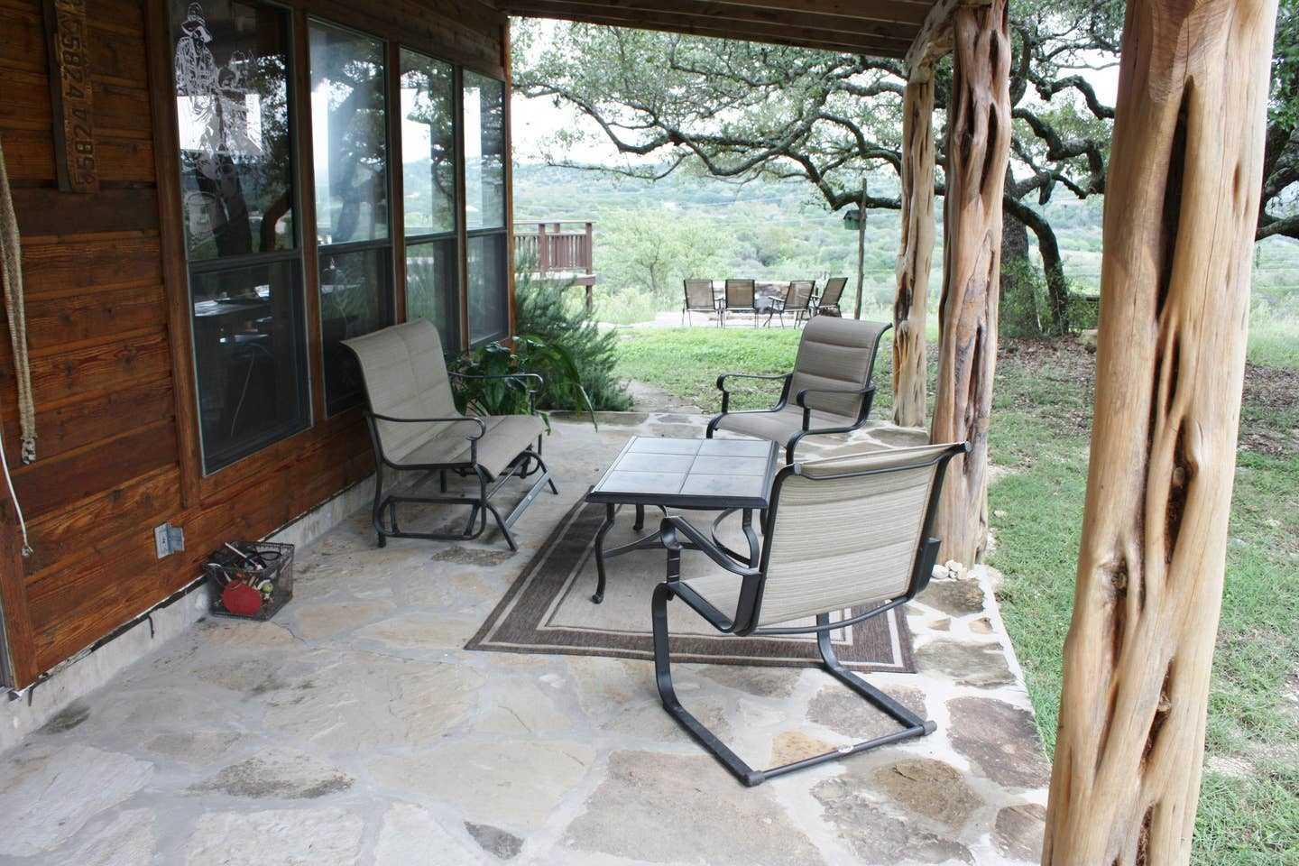 Comfy outdoor furniture makes the shaded patio a great place for conversation and wildlife watching.