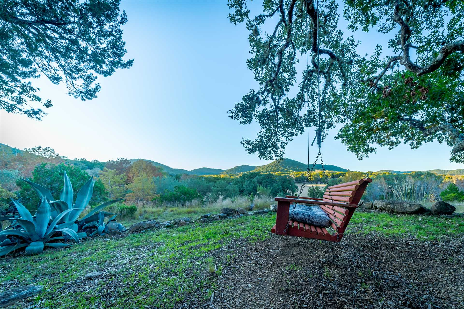 You'll want to take a seat on the swing here! It's a wonderful romantic setting, and the mountain views are breathtaking.