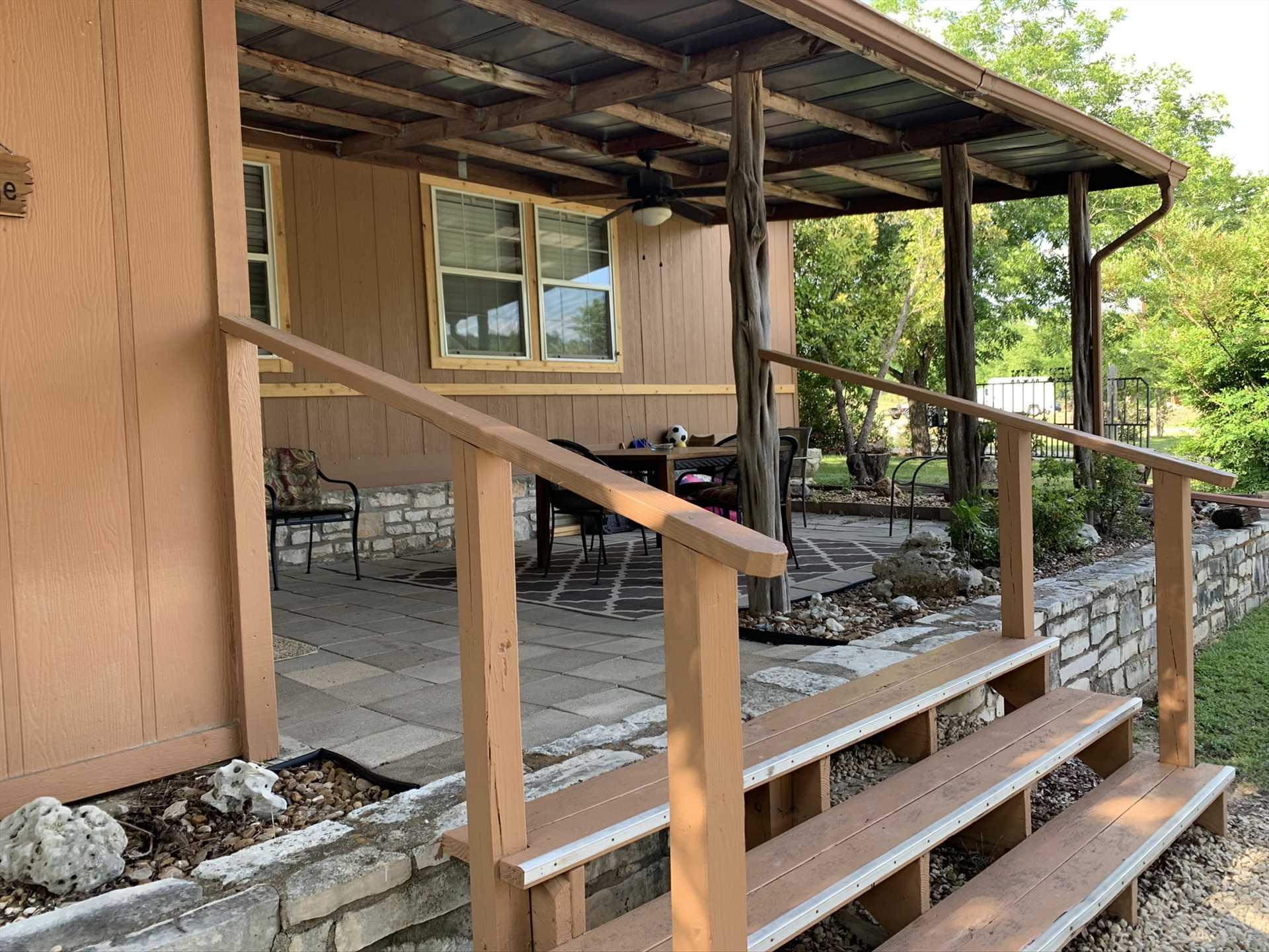 The front porch has plenty of outdoor furniture, and is shaded so you can enjoy the fresh air out of the Texas sun.