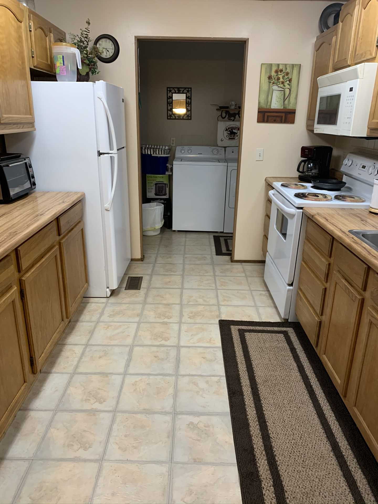 Beyond the fully decked-out kitchen, you'll also find a convenient utility room, complete with a washer and dryer!
