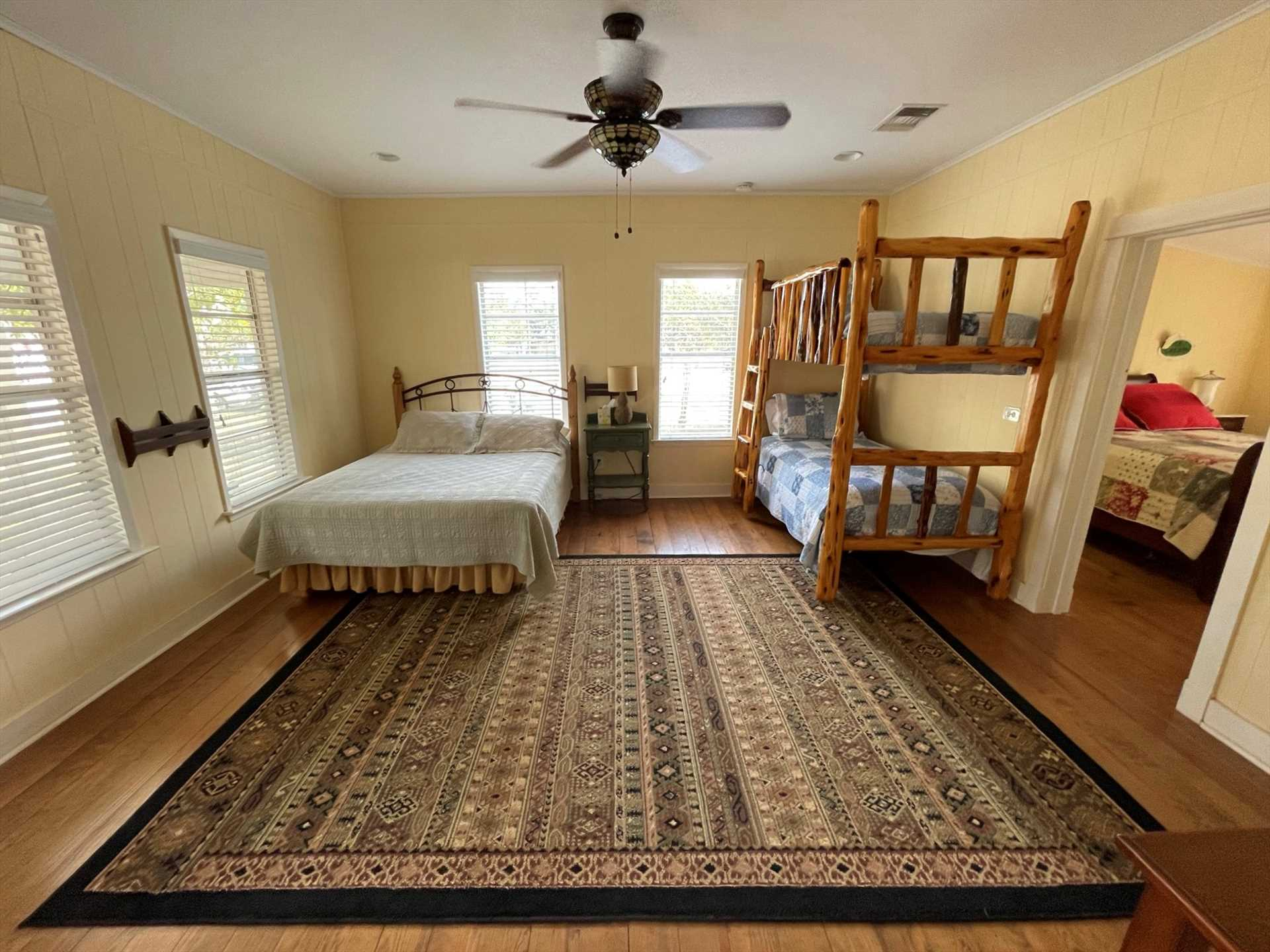 Soft and warm queen and twin bunk beds comfortably sleep up to four guests in the second bedroom. Clean linens are included, too!
