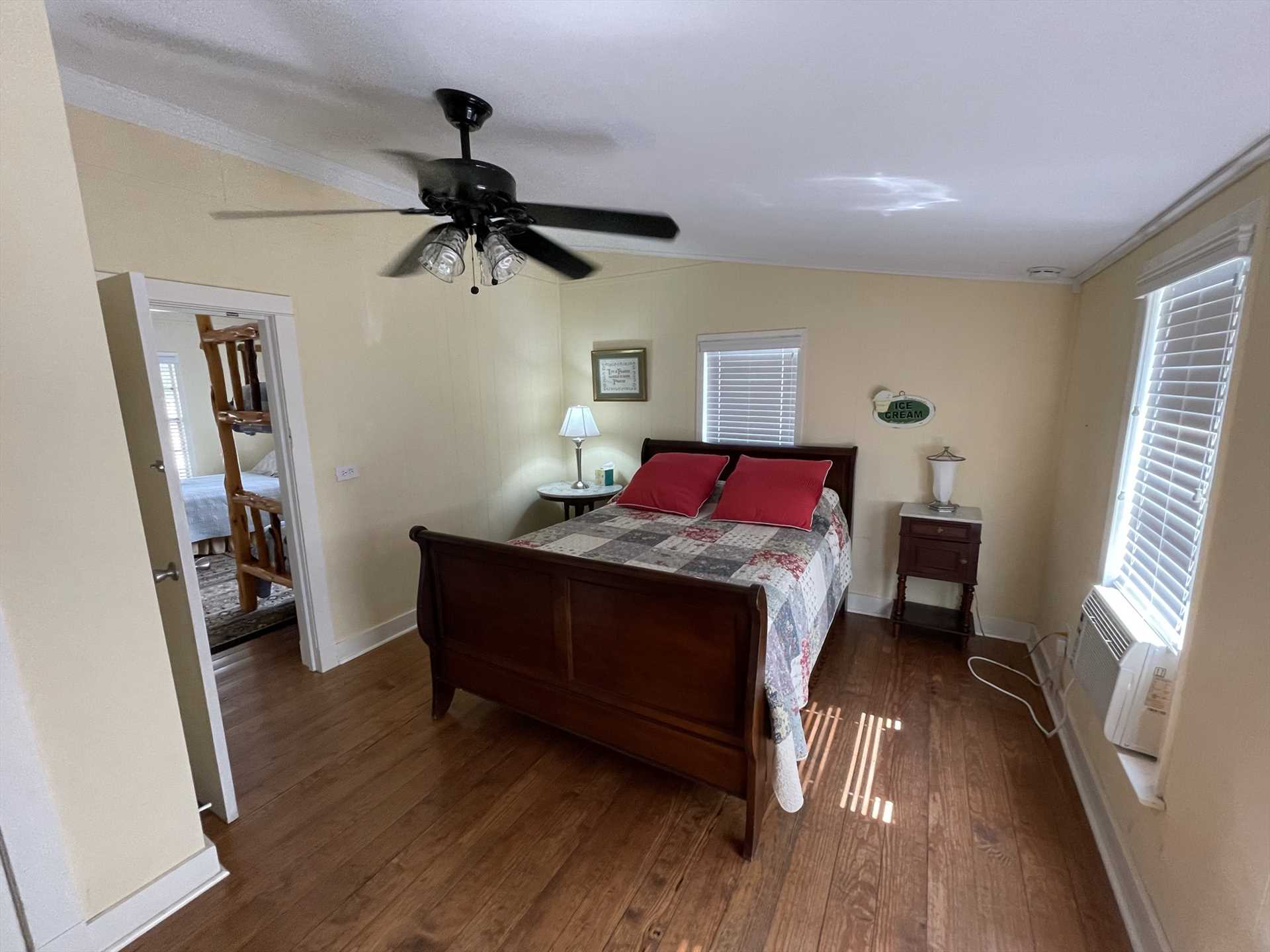 Natural light awakens you gently in the master bedroom, with a comfy queen-sized bed for two guests.