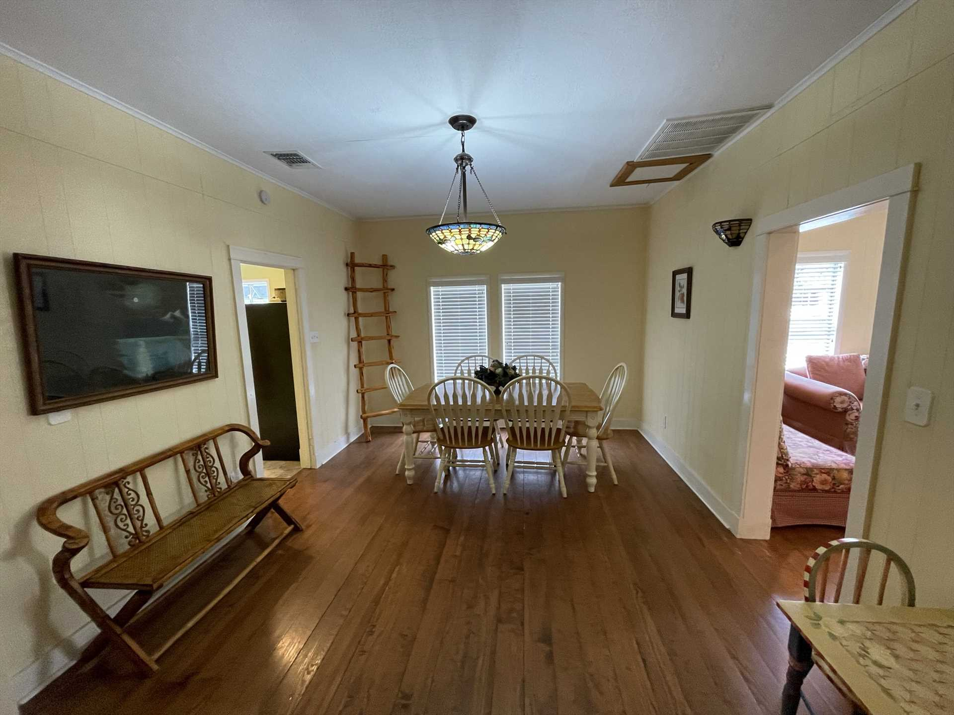 Enjoy delicious meals, and have some game night fun, around the charming and roomy dining room table!