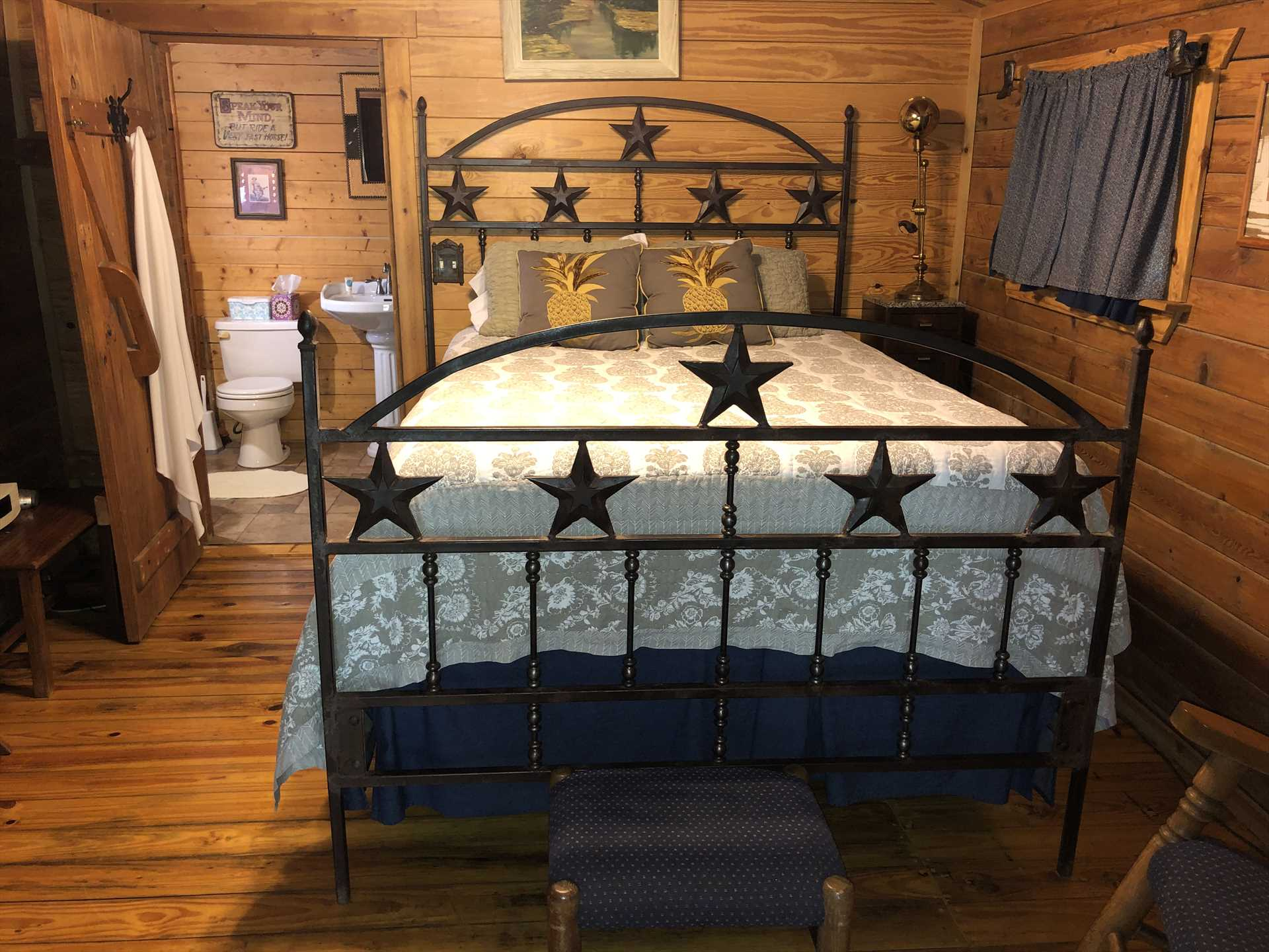 Check out the uniquely-Texan Lone Star frame on the big and comfortable queen-sized bed!