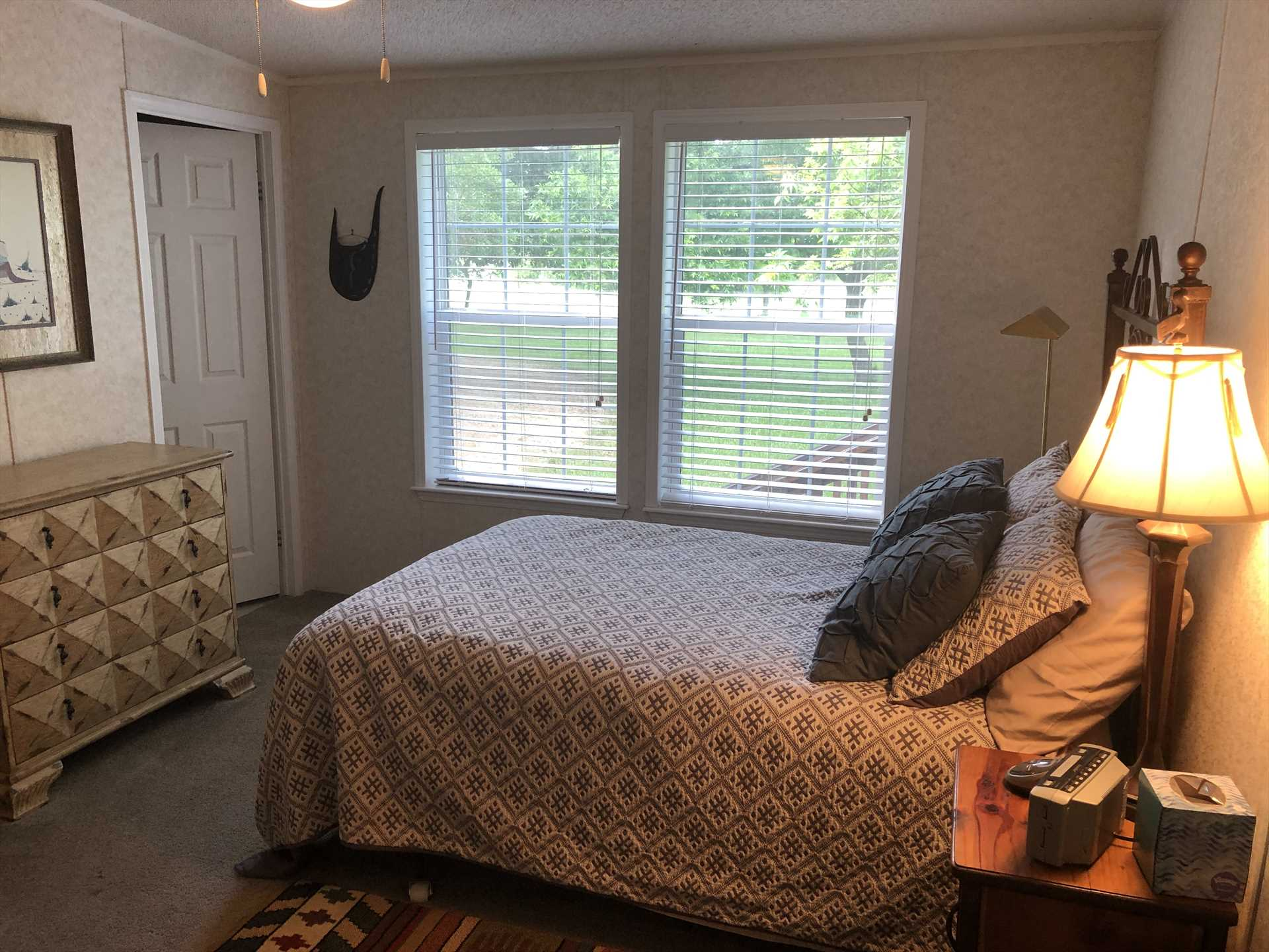 The plush and comfortable double bed in the third bedroom comes with clean linens, as do all the sleeping arrangements here.