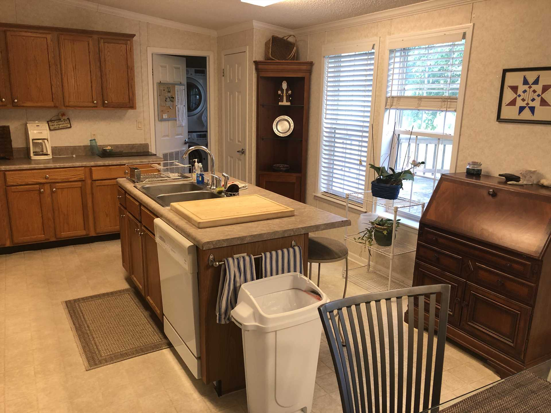 Beyond the fully-appointed kitchen, you'll see a new washer and dryer combo installed for your convenience!