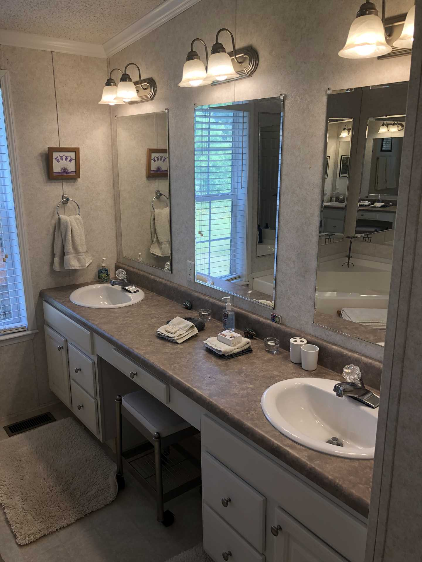Twin mirrored vanities, tons of counter space, and a generous supply of clean bath linens round out what you'll find in the master bath.