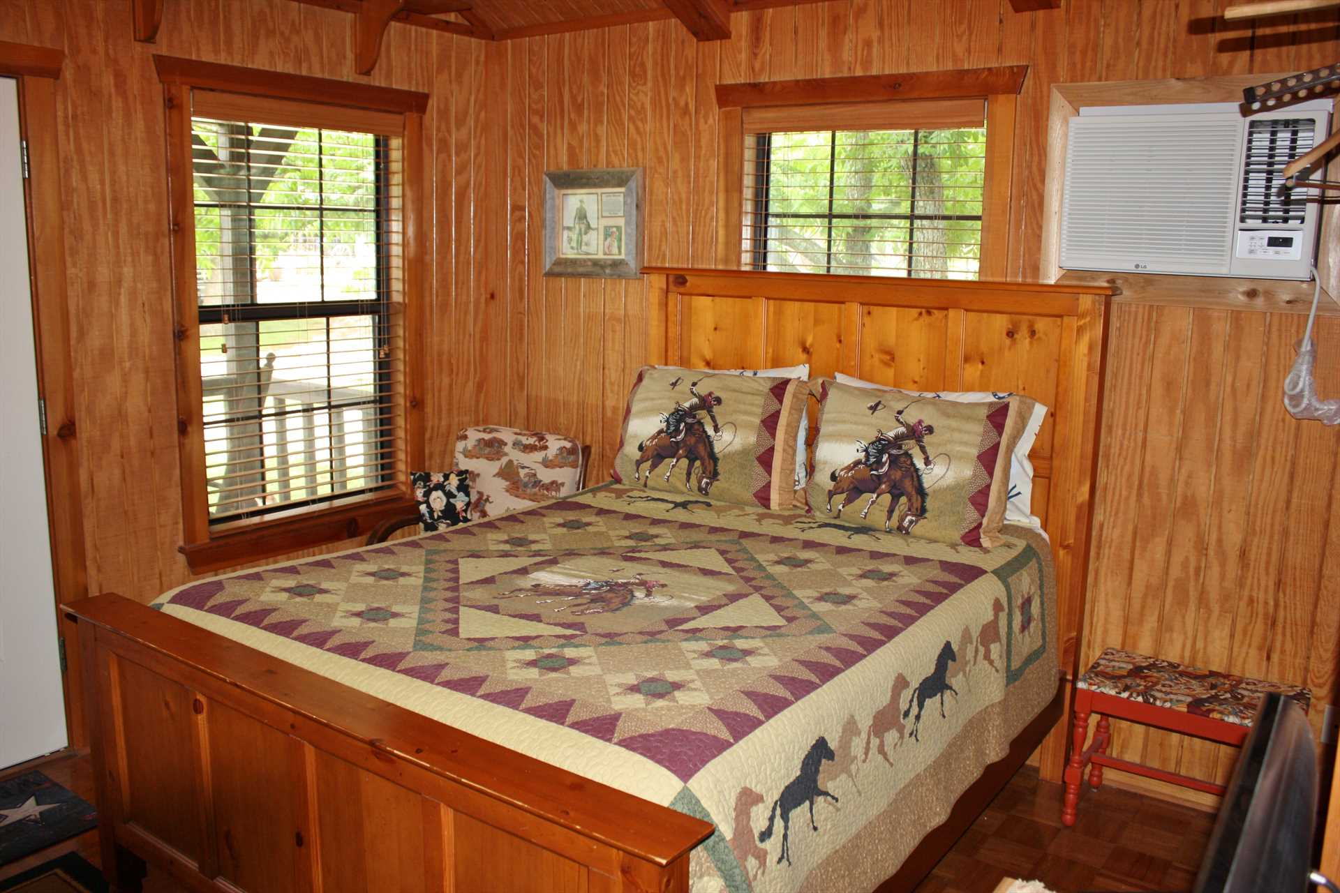 The framework of the huge and comfy queen bed matches the gorgeous woodwork you'll find throughout the cabin.