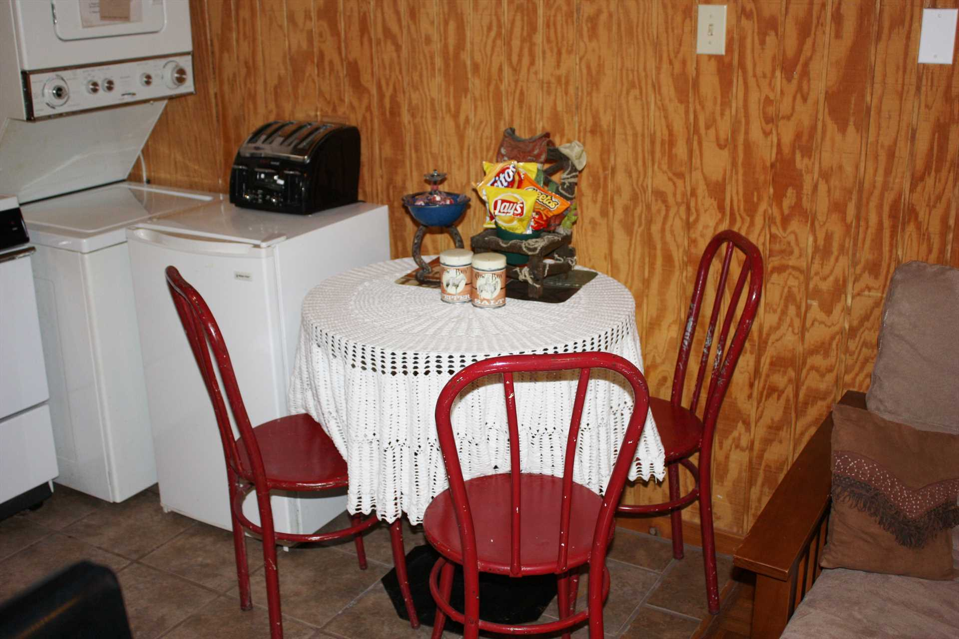 The kitchen includes a cozy dining nook, and for your convenience the cabin is also furnished with a stacked washer and dryer combo.