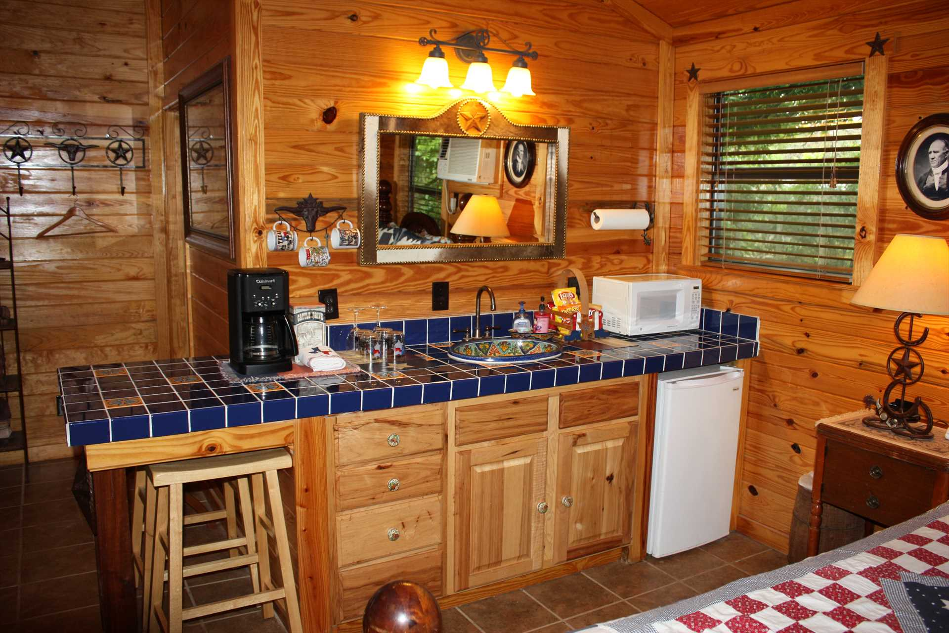 The cozy kitchenette takes care of your basic necessities, complete with complimentary beverages.