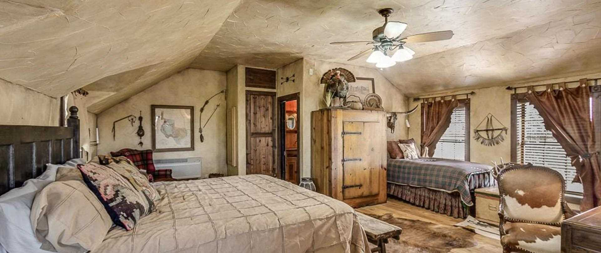 The rustic style of the master suite is something you'll never find in a motel room!