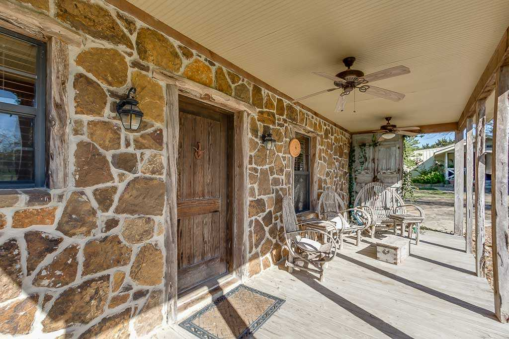 Even when the covered front porch isn't in shade, there are ceiling fans to keep the space cool!