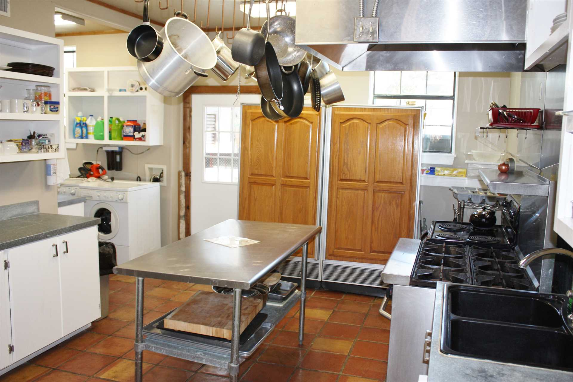 No bumping into one another here! The huge chef's kitchen has room, appliances, and cookware for even the most discriminating of cooks.
