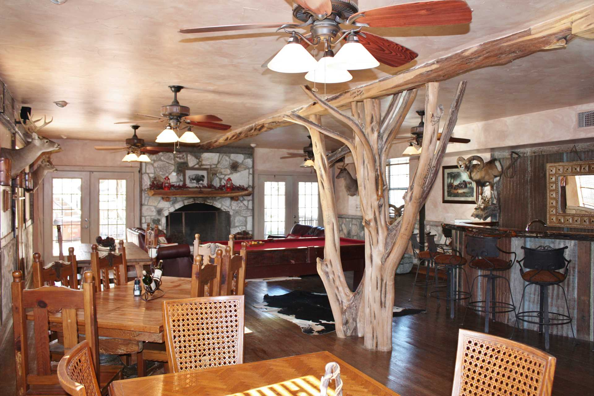 Unique wood and wicker work grace the inviting common area of the ranch's dining room.