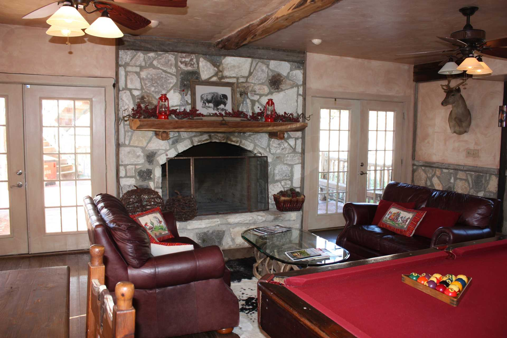 A regal stone fireplace and beamed ceiling are just two of the charming touches you'll find at 7 Canyons Ranch.
