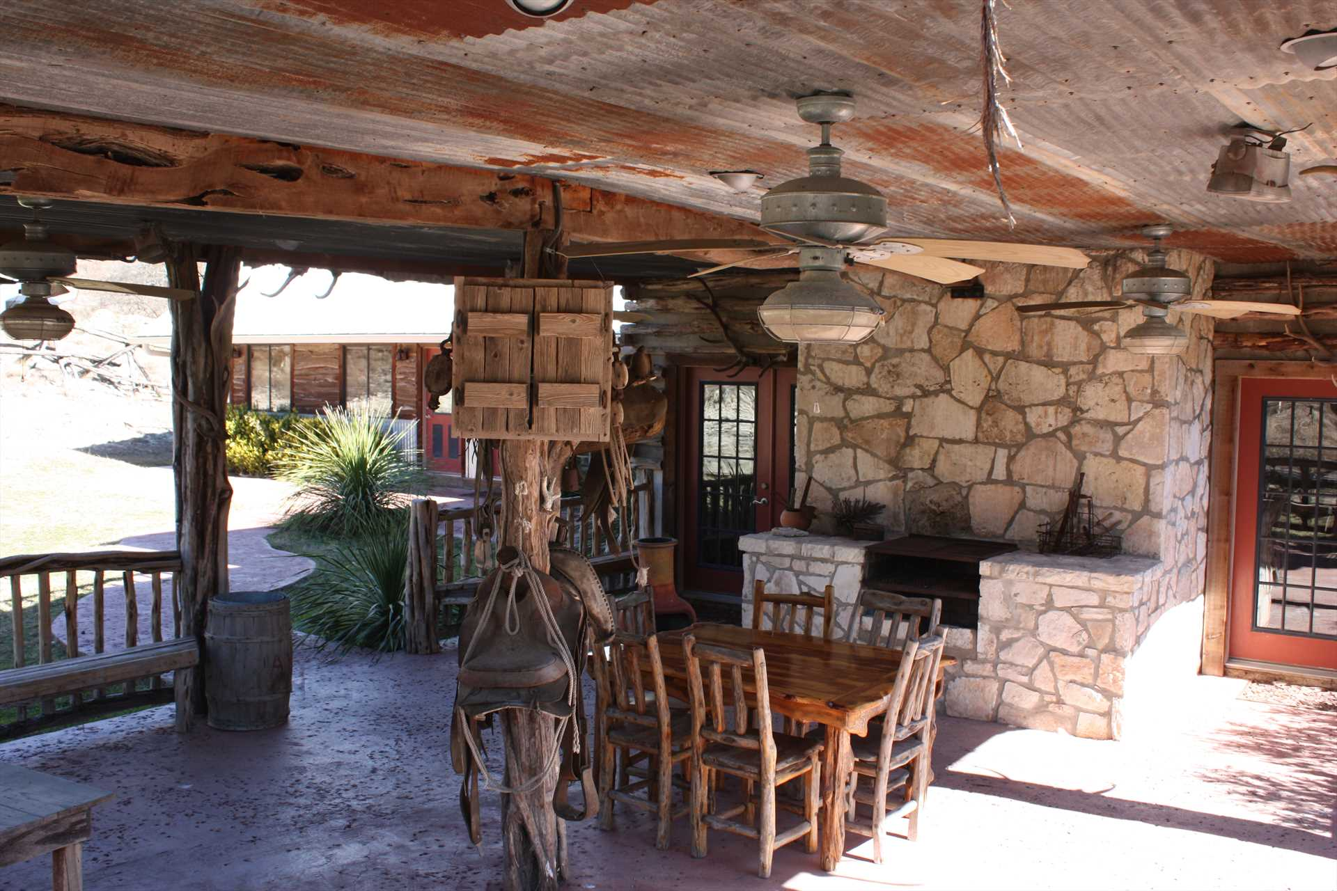 Cool breezes and shaded comfort surround the grill on the lower level patio.