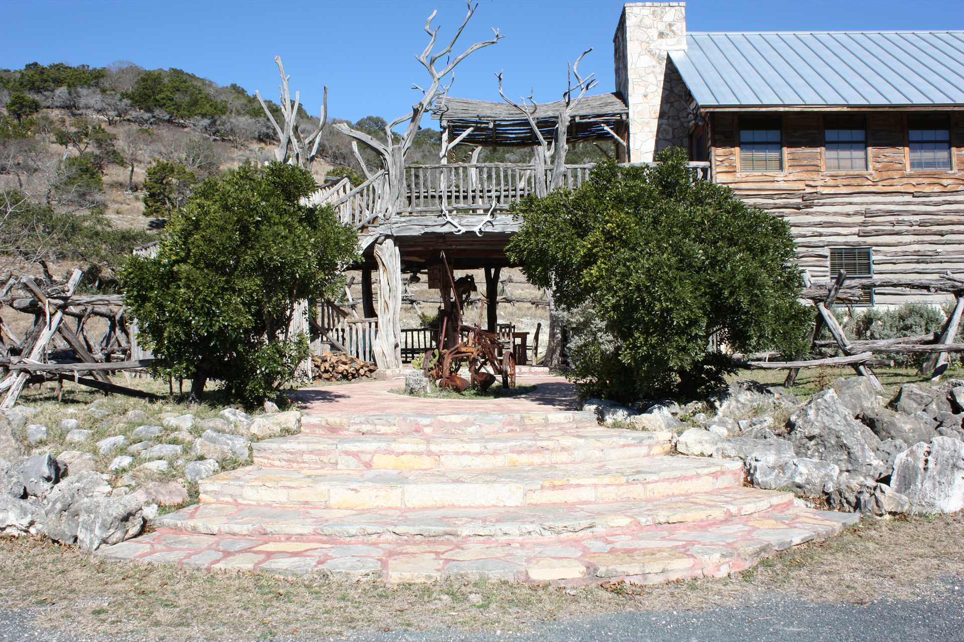 Immaculate grounds and rustic western lodge atmosphere greet you to this wonderful Hill Country hideaway!