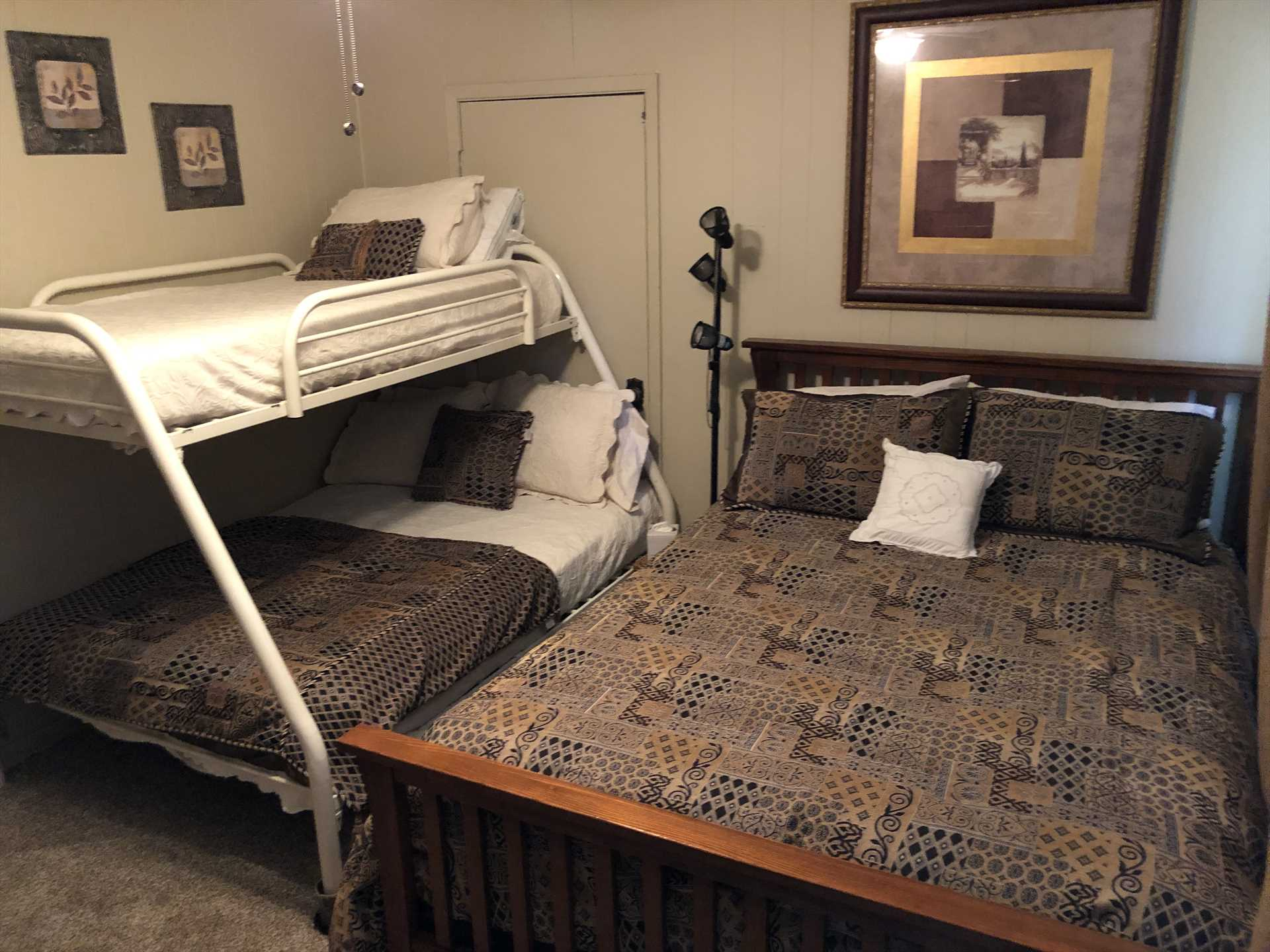 Up to five guests can sleep peacefully in the third bedroom, with a queen bed and a double down/twin up bunk bed. This space serves perfectly as a kids' room!