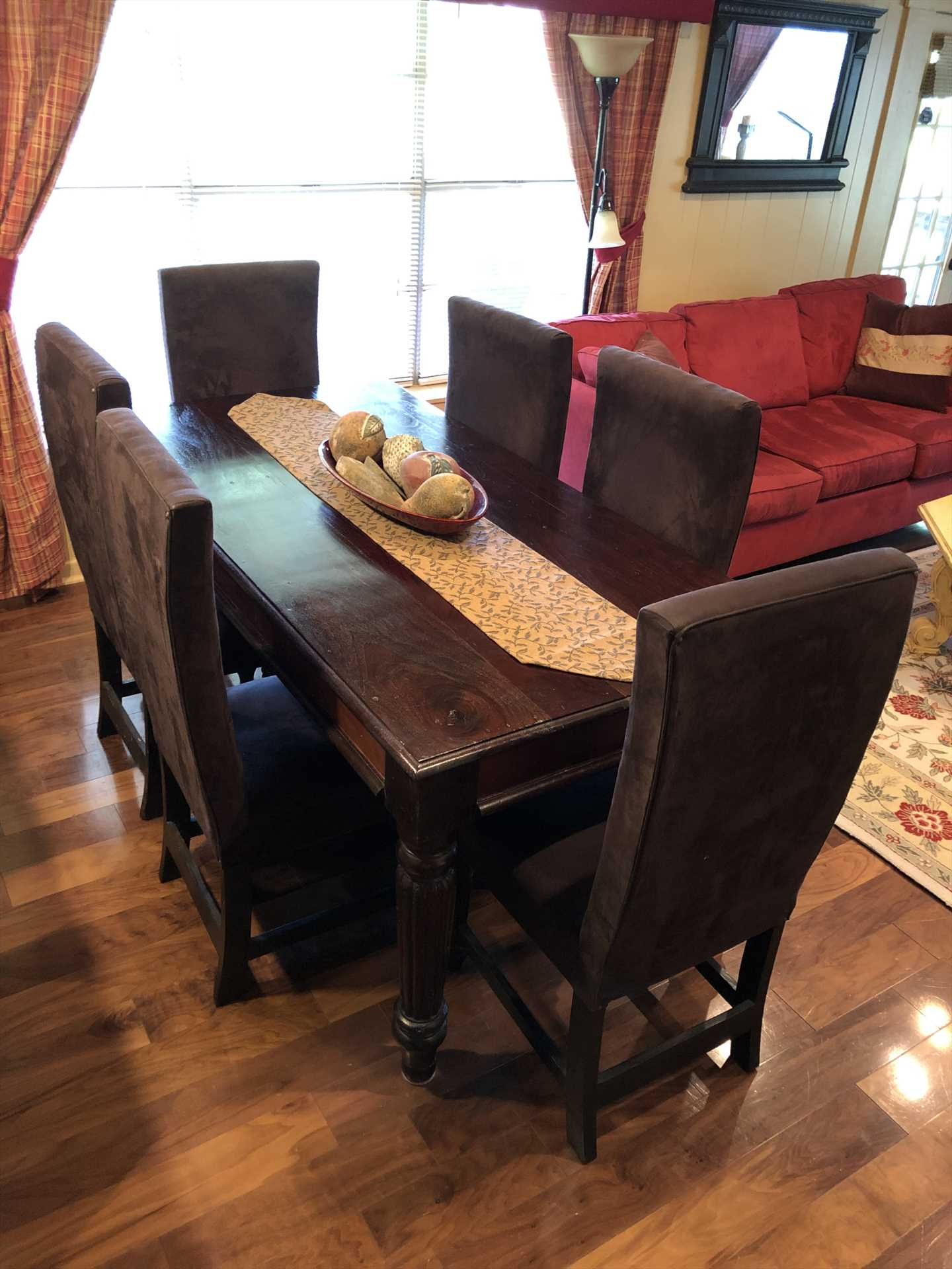 Seat yourself and dig in around the delightful dining room table!