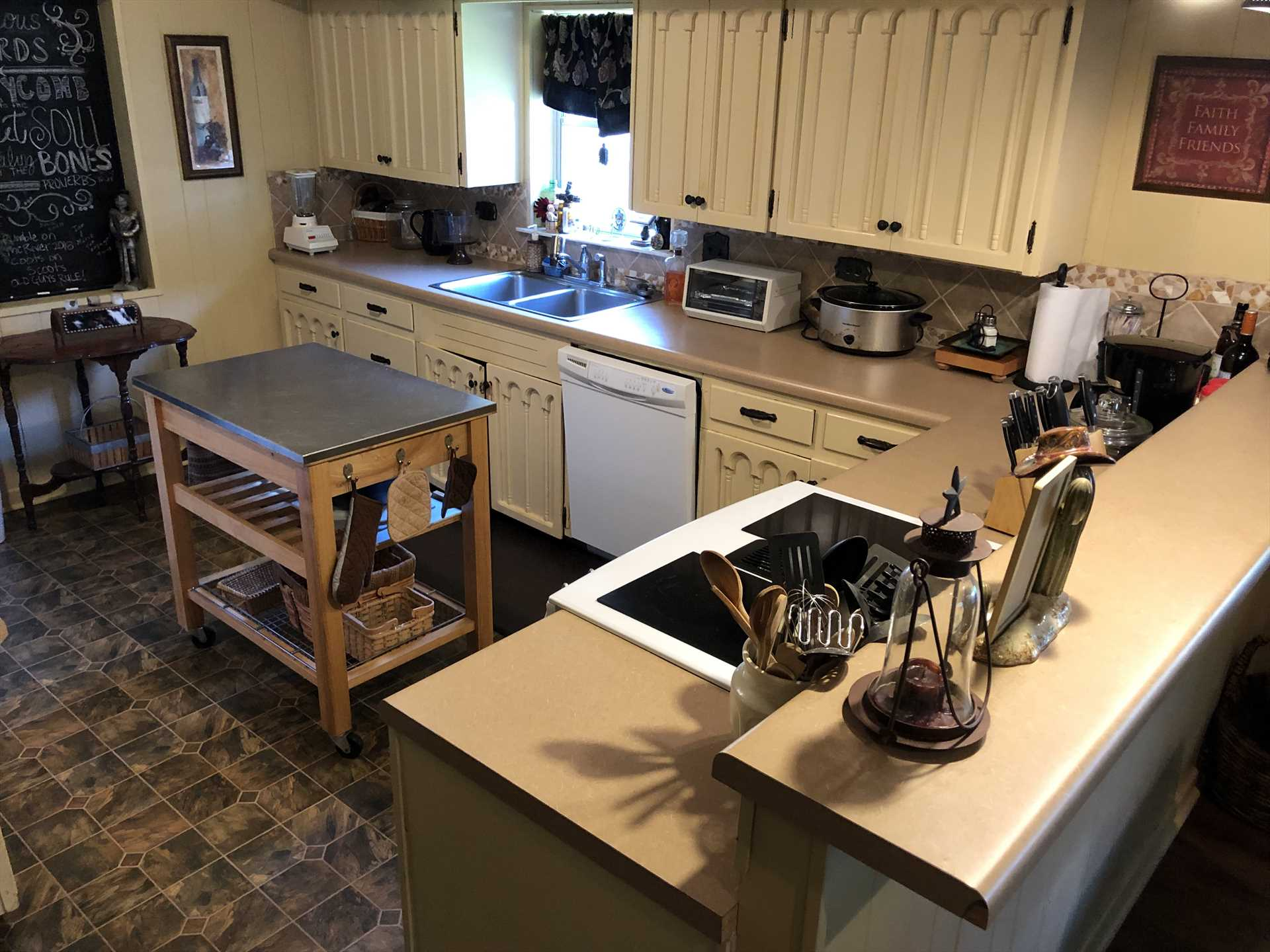 The big country kitchen is stocked with all the appliances and utensils your crew will need for a delicious home-cooked meal!