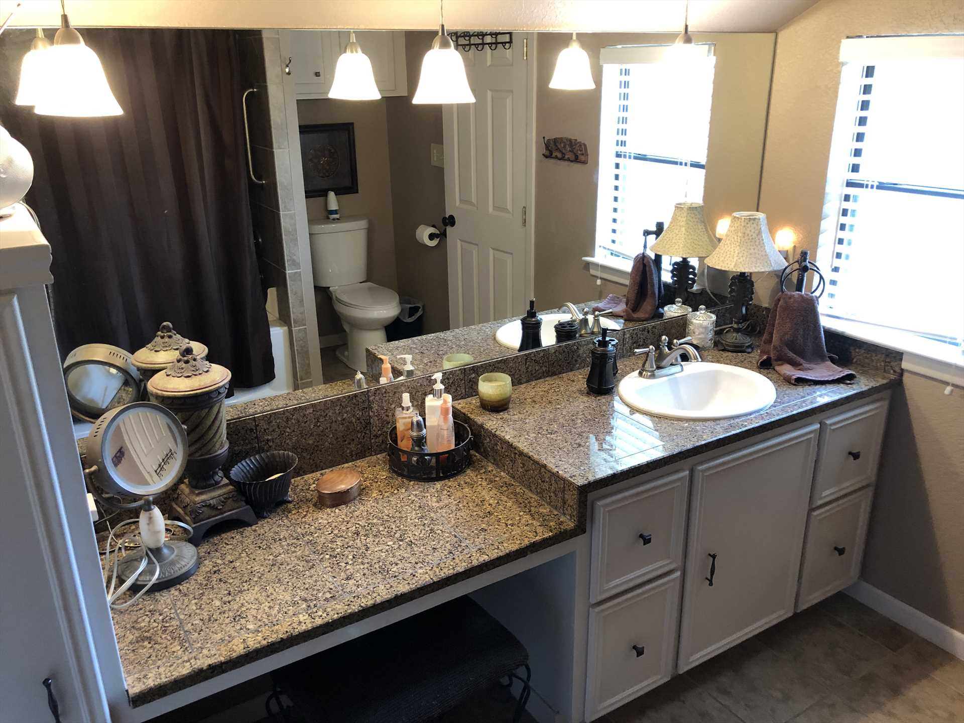 The master bath includes a roomy mirrored vanity and tub and shower combo. Clean bath linens are provided for guests throughout the house, too.