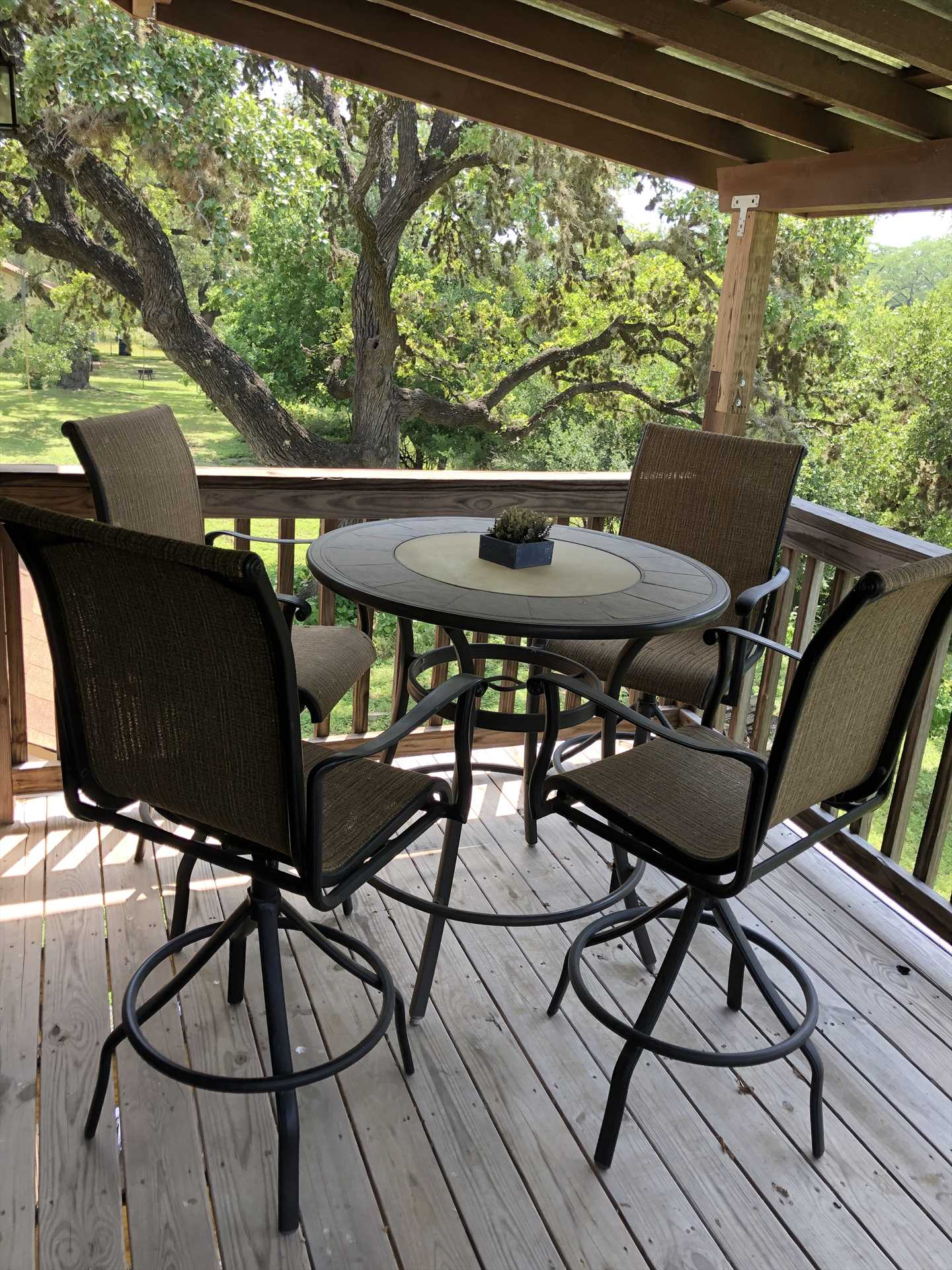 Conversation and relaxation are yours whenever you'd like in the comfy patio furniture on the shaded deck.