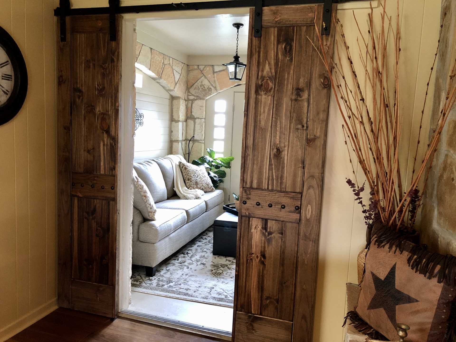 The barn door access to the foyer is just one of the homey touches that gives the guest house a personality all its own.