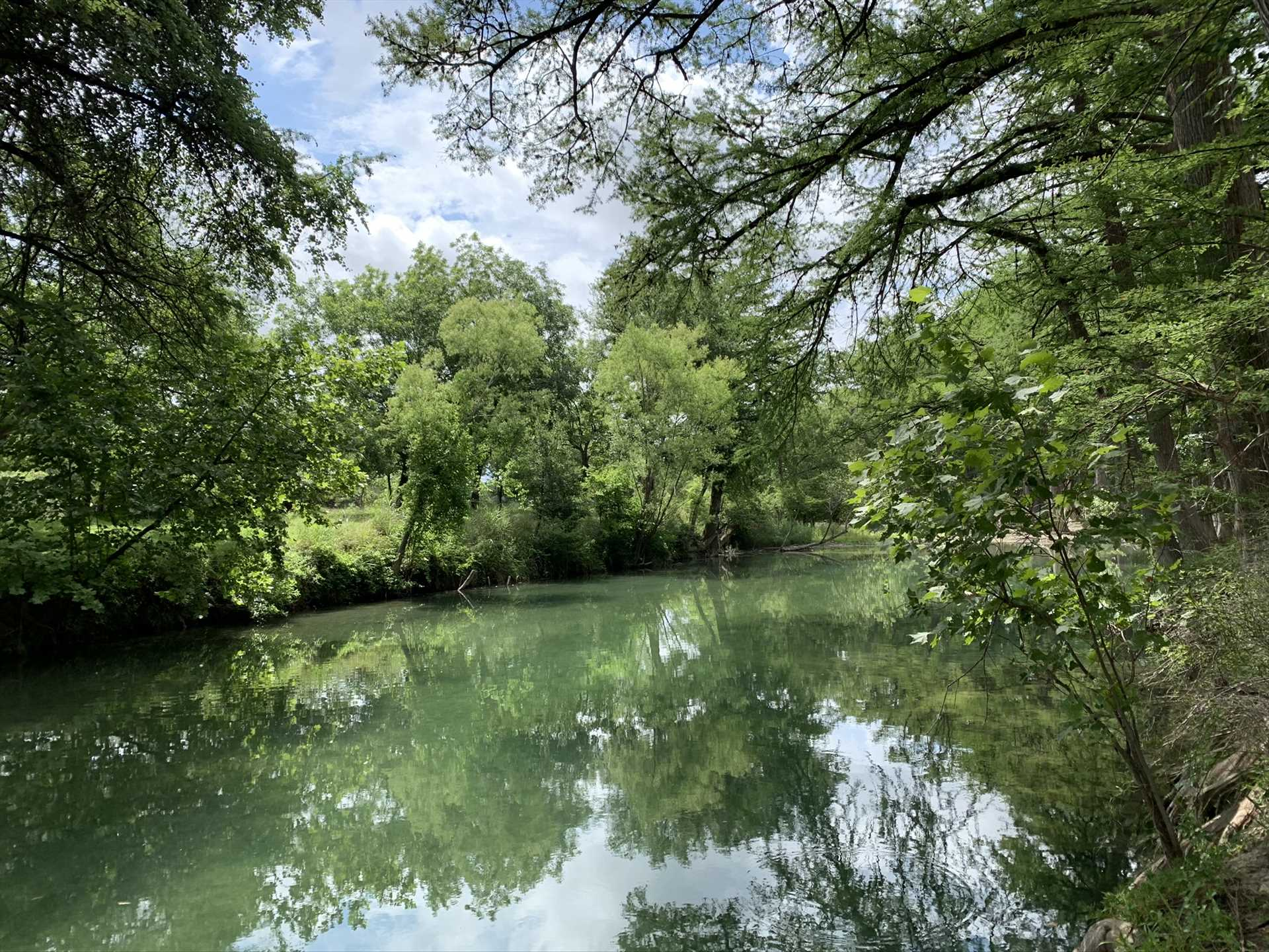 Can you see yourself tubing or swimming in this peaceful stretch of the river? We'd love to help put you there!