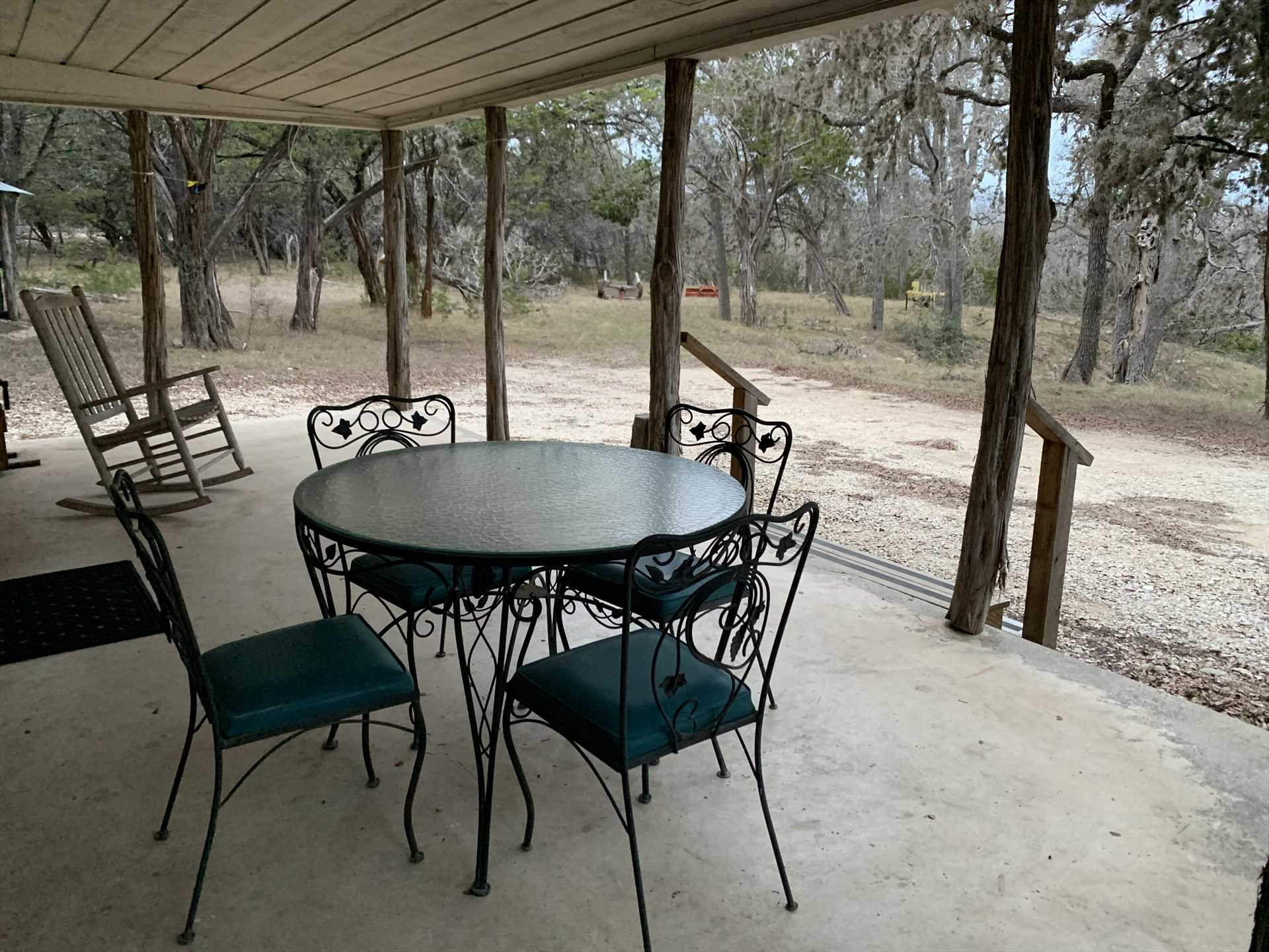 You can almost feel the soft Hill Country breezes as they cool you off on the shaded porch.